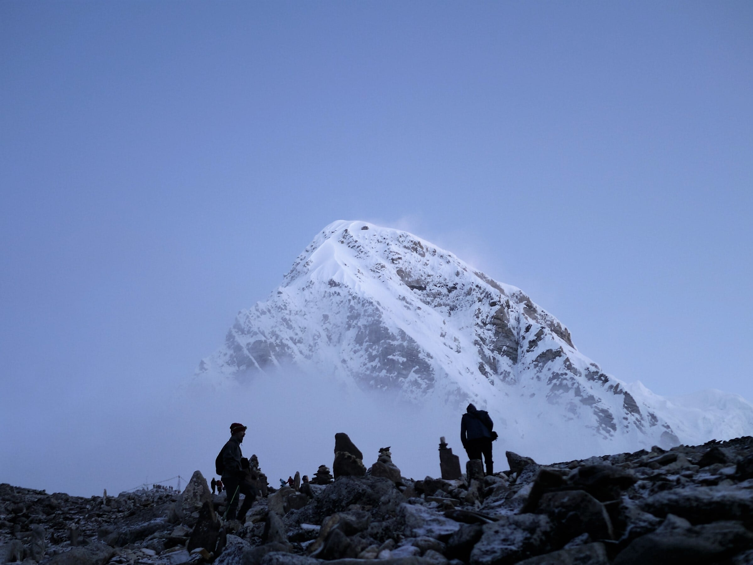 mountaineers near snow-covered mountain