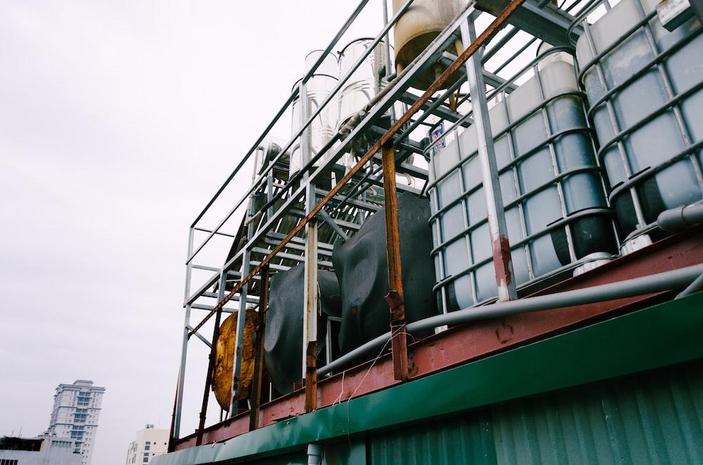 white IBC tanks on green building