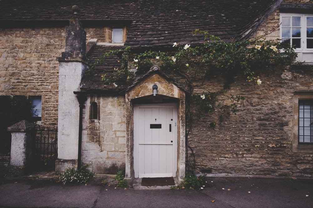 landscape photo of closed white door