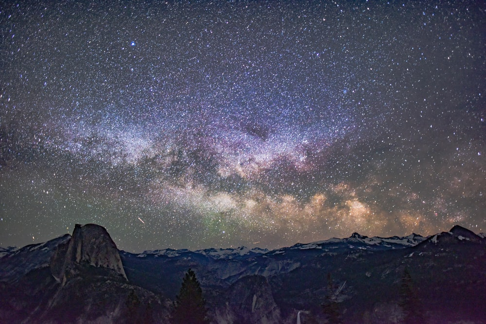 mountain under starry sky