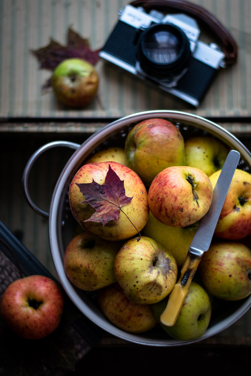 flat lay photography of pot of apples