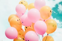 low-angle photo of pink and orange balloons