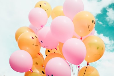 low-angle photo of pink and orange balloons balloons teams background