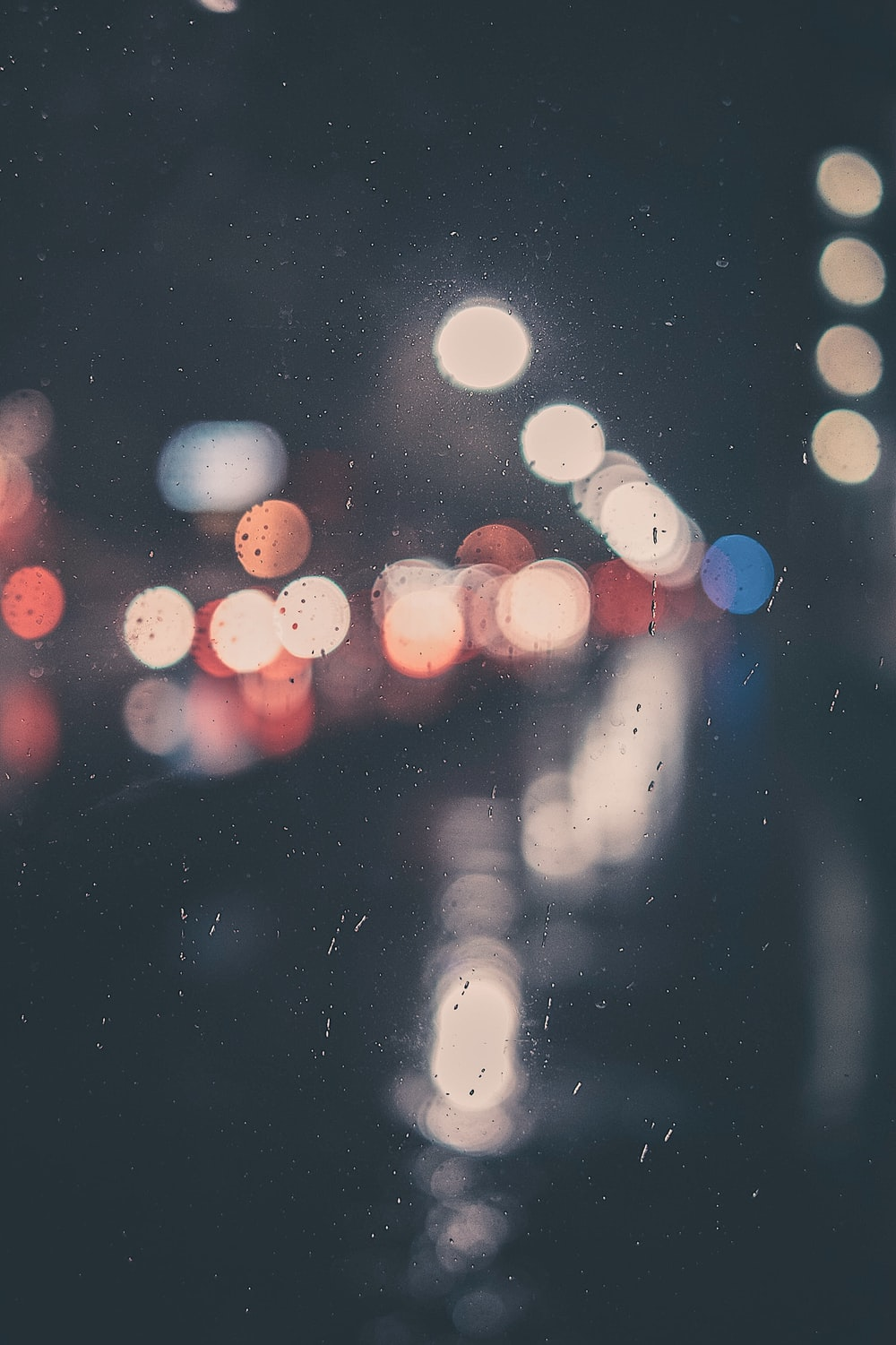 bokeh photography of clear glass panel with light