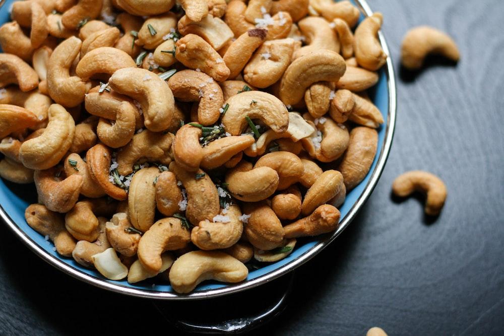 cashew nut lot on blue ceramic bowl. Flexitarian protein source. Flexitarian Diet.