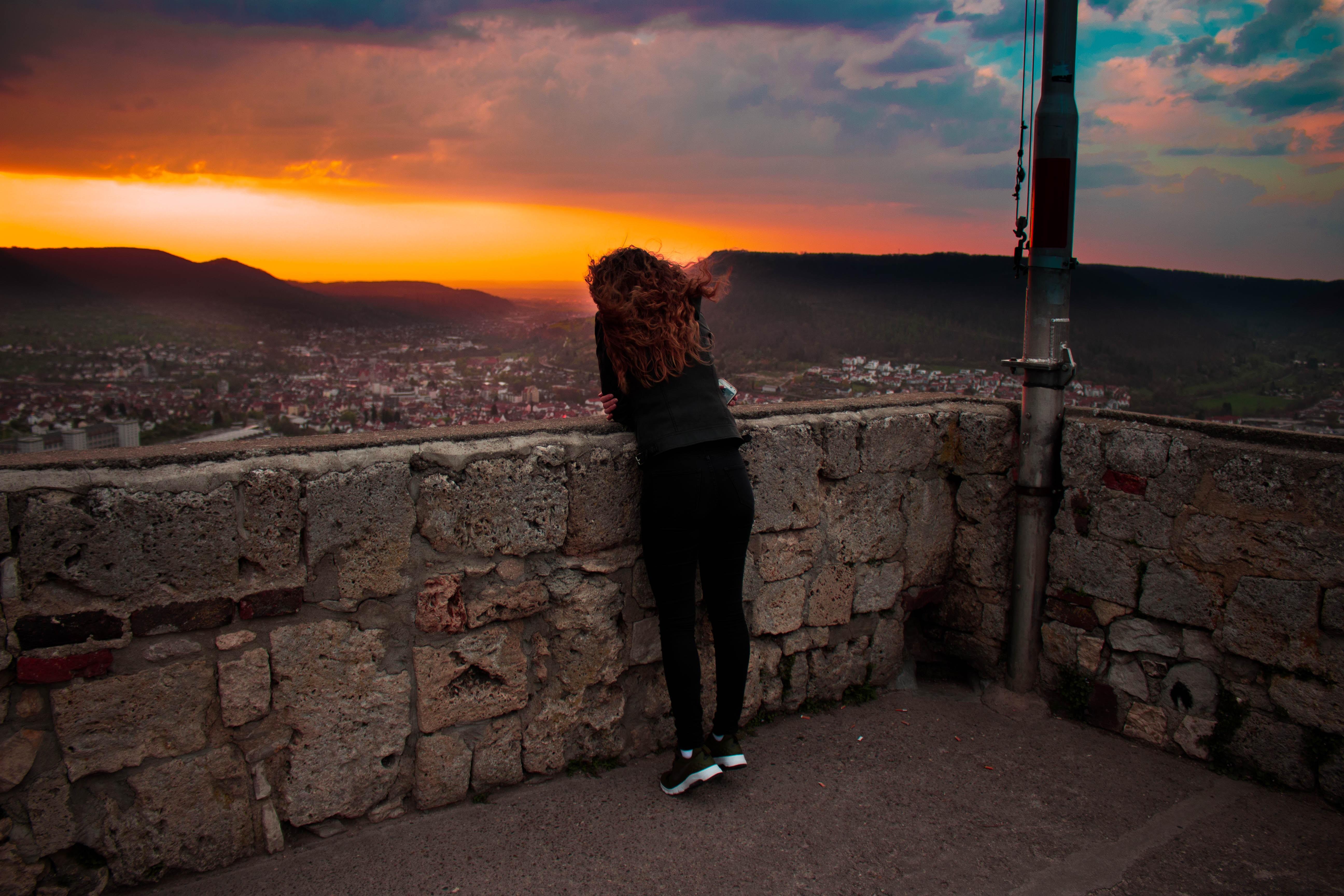 woman wearing black legging during sunset