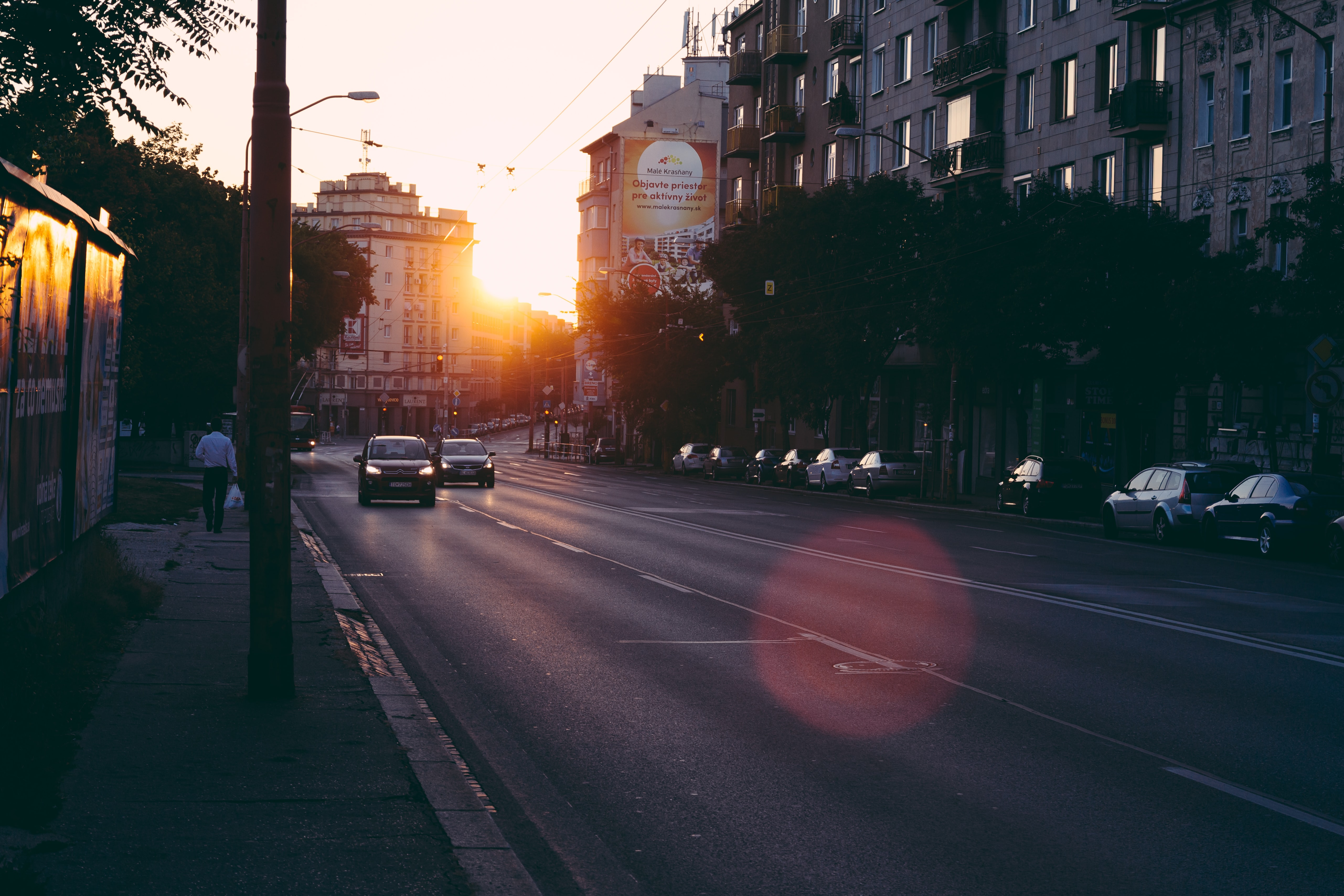 two vehicle on road during sun rise