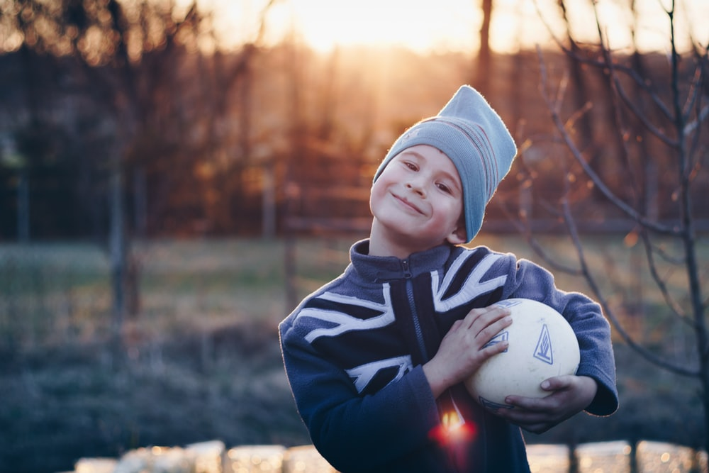 boy holding a ball