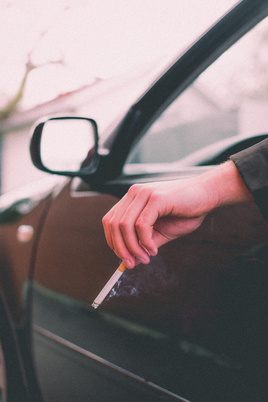 My friends and I were on a short film set for our class at school, and our main actor needed to smoke a cigarette so I told him to stay in the car. I was waiting for this moment without having to force it or to set up a shot. It all happened naturally and that's the beauty of photography.