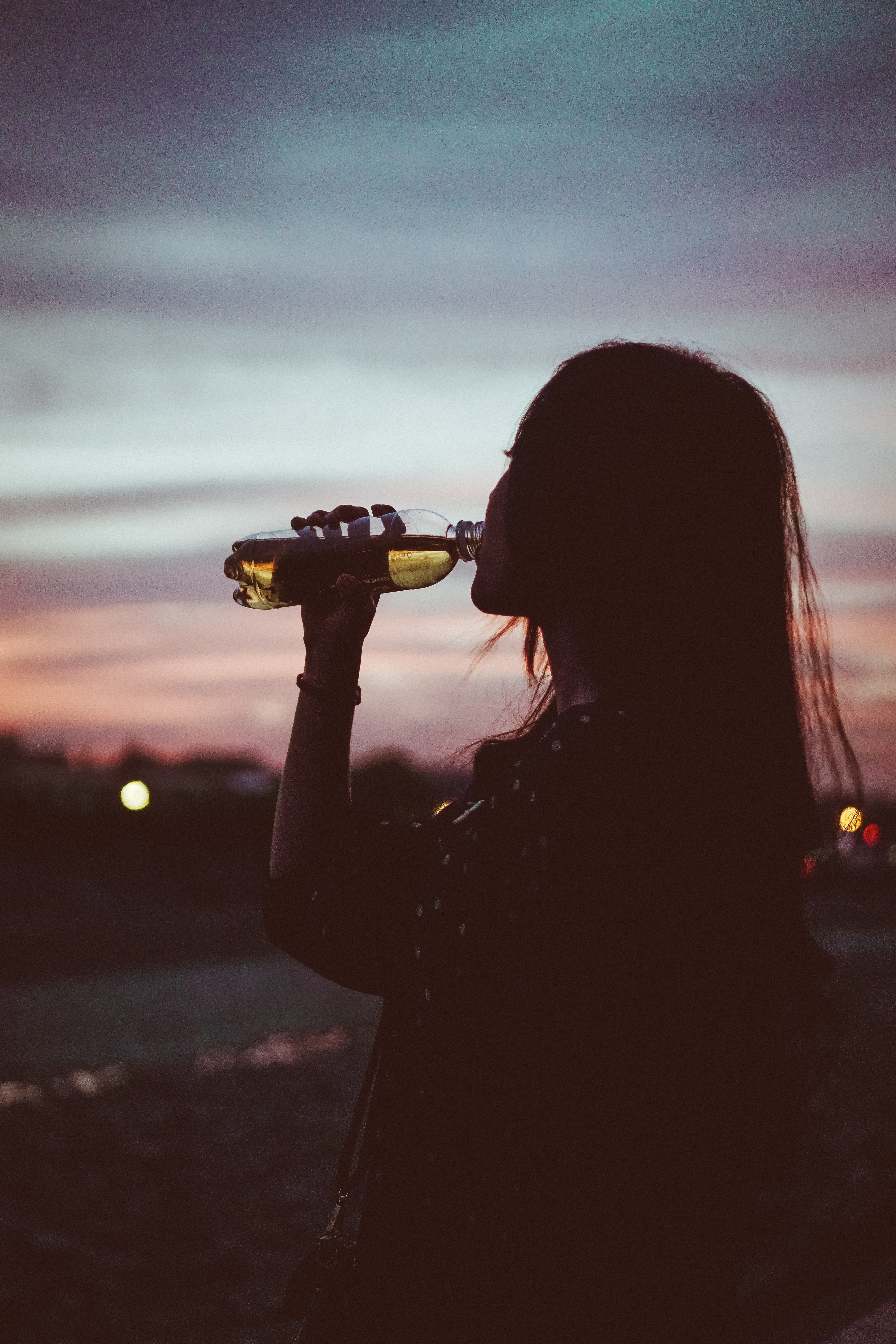 silhouette photo of woman drinking water