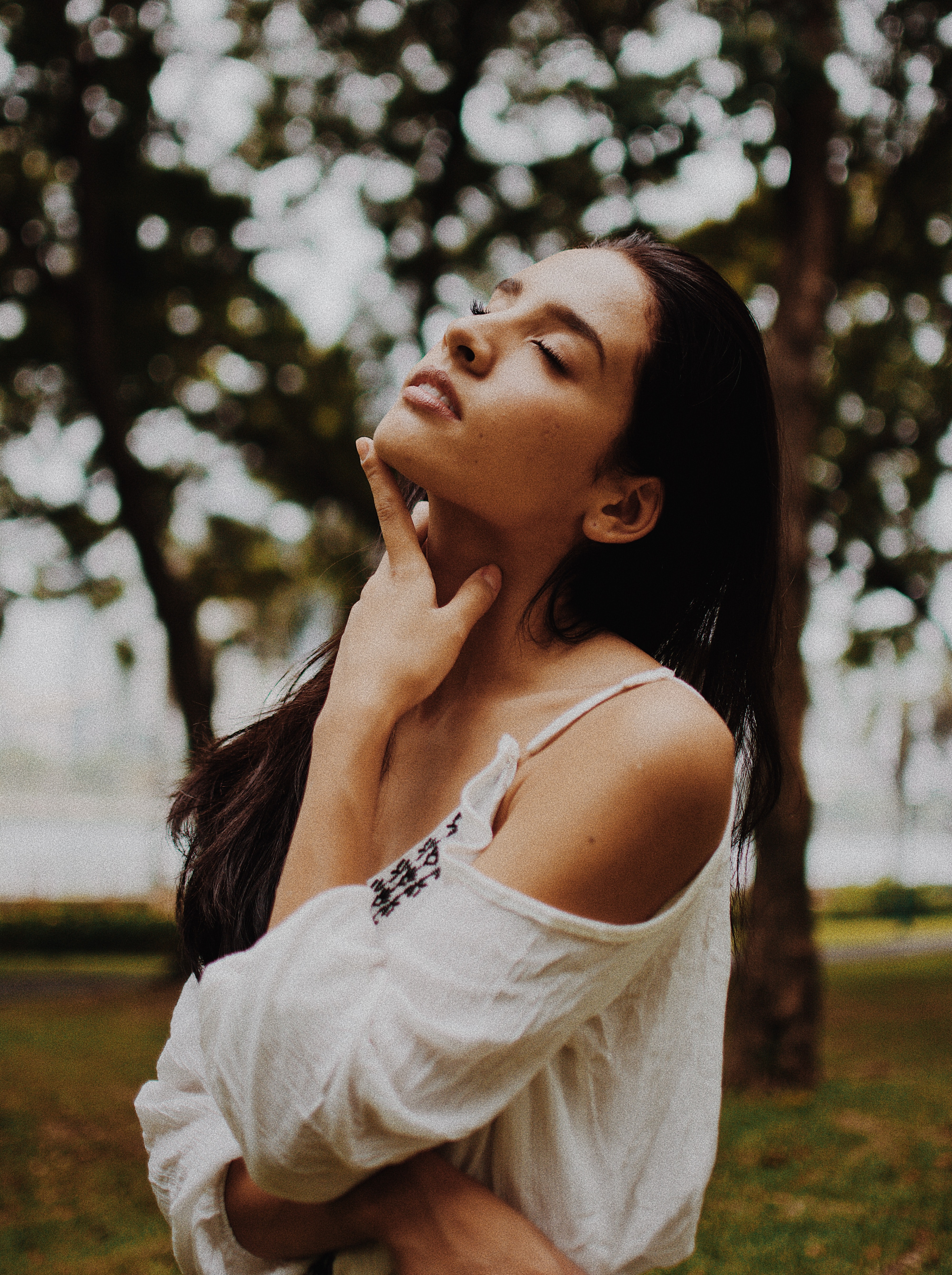 shallow focus photography on woman in white cold-shoulder top