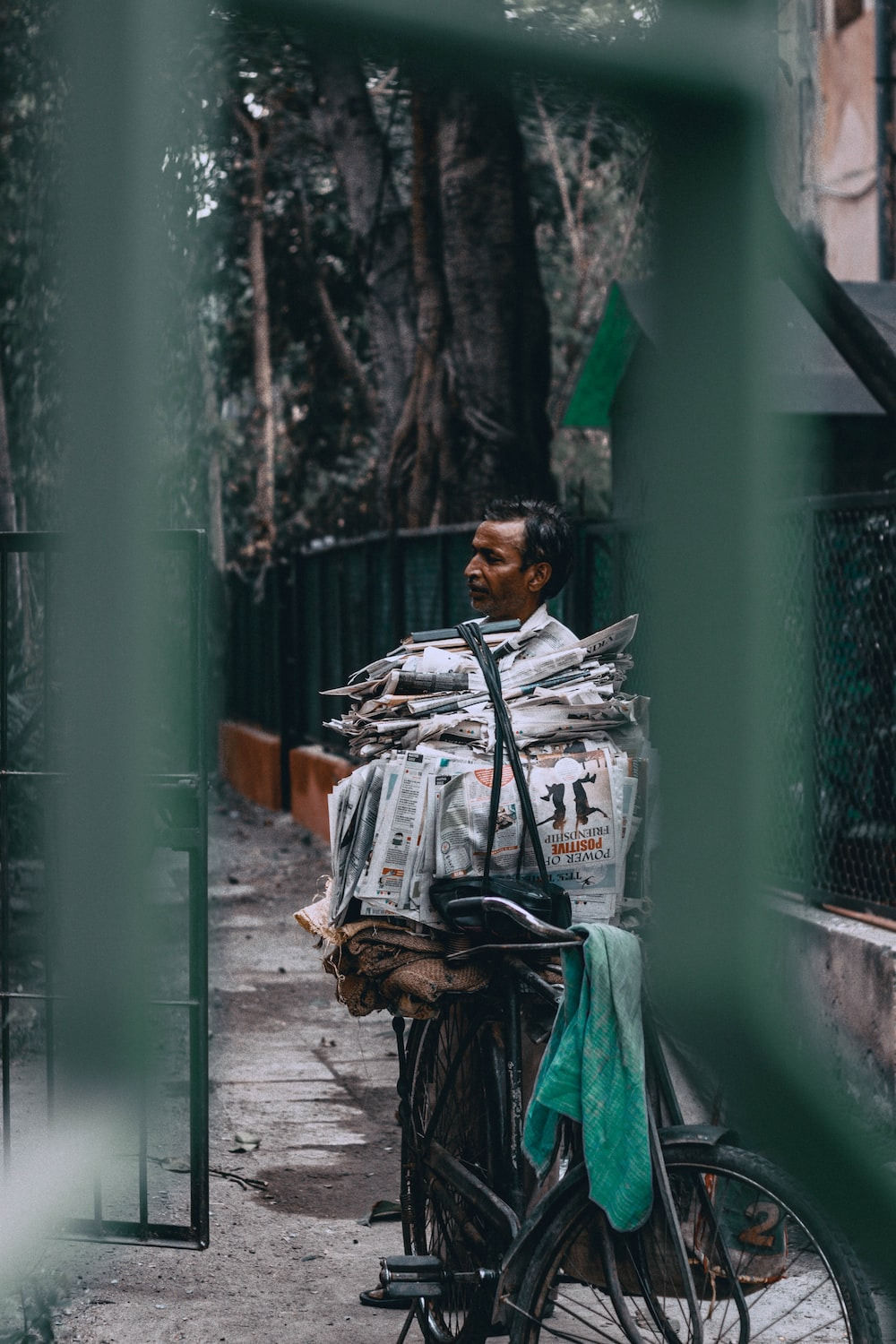man near on pile of newspapers