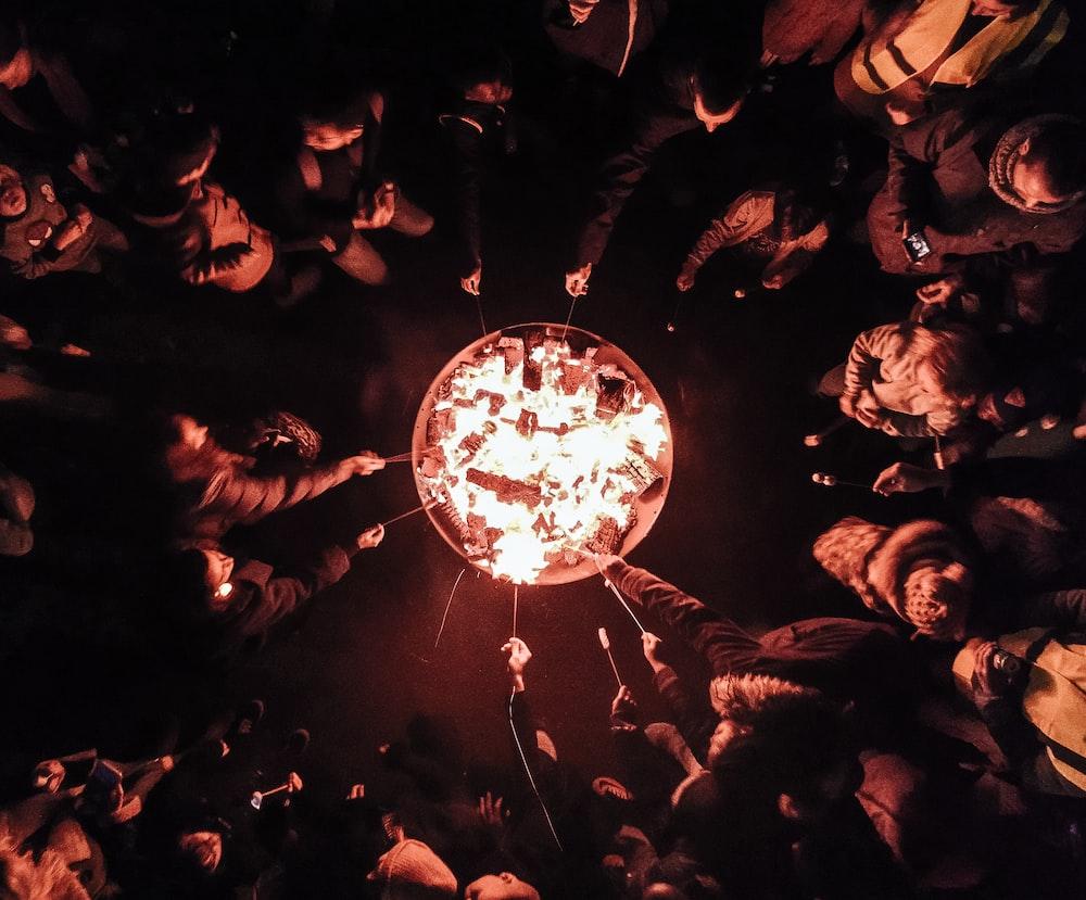 people near bonfire