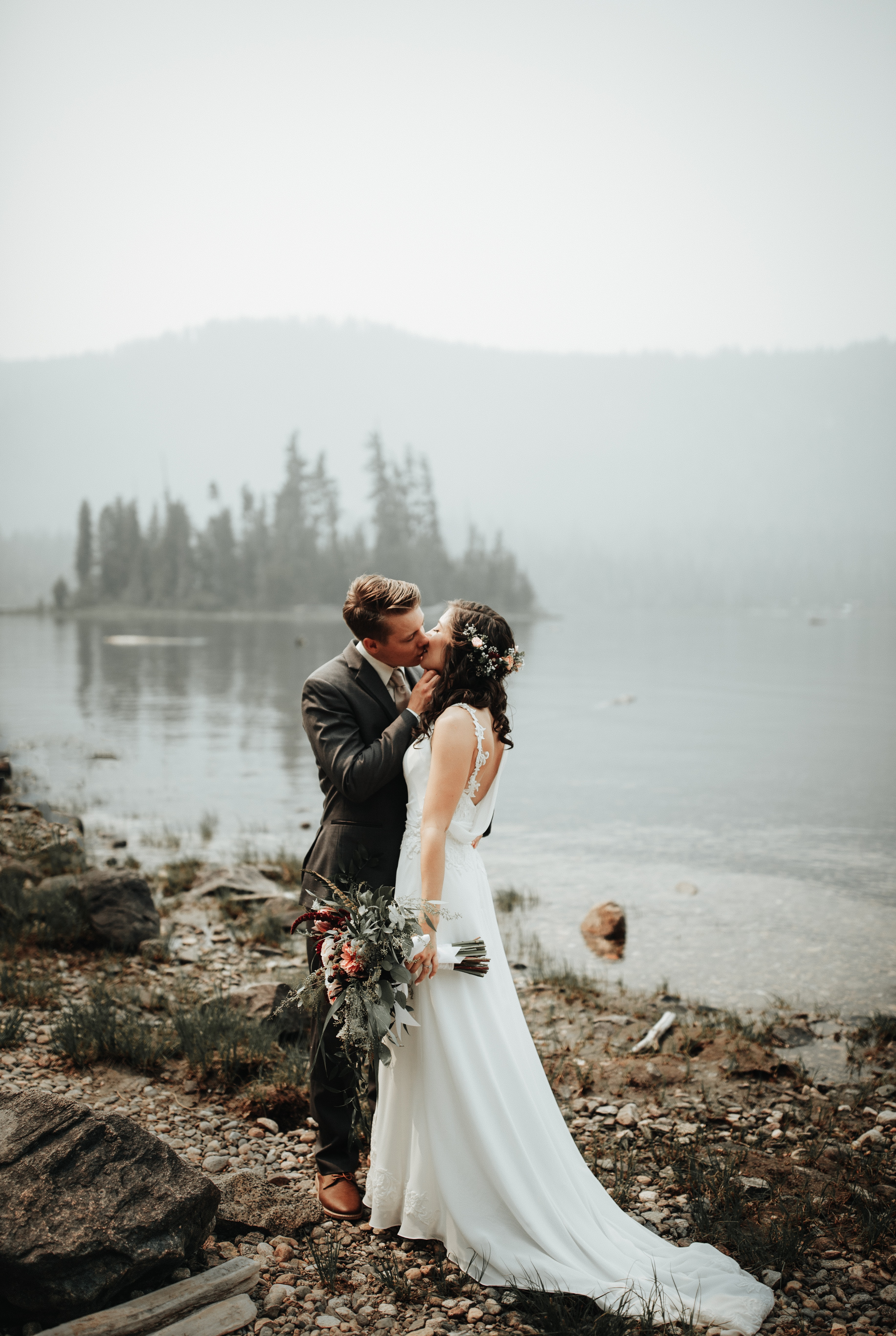 man and woman kissing during wedding