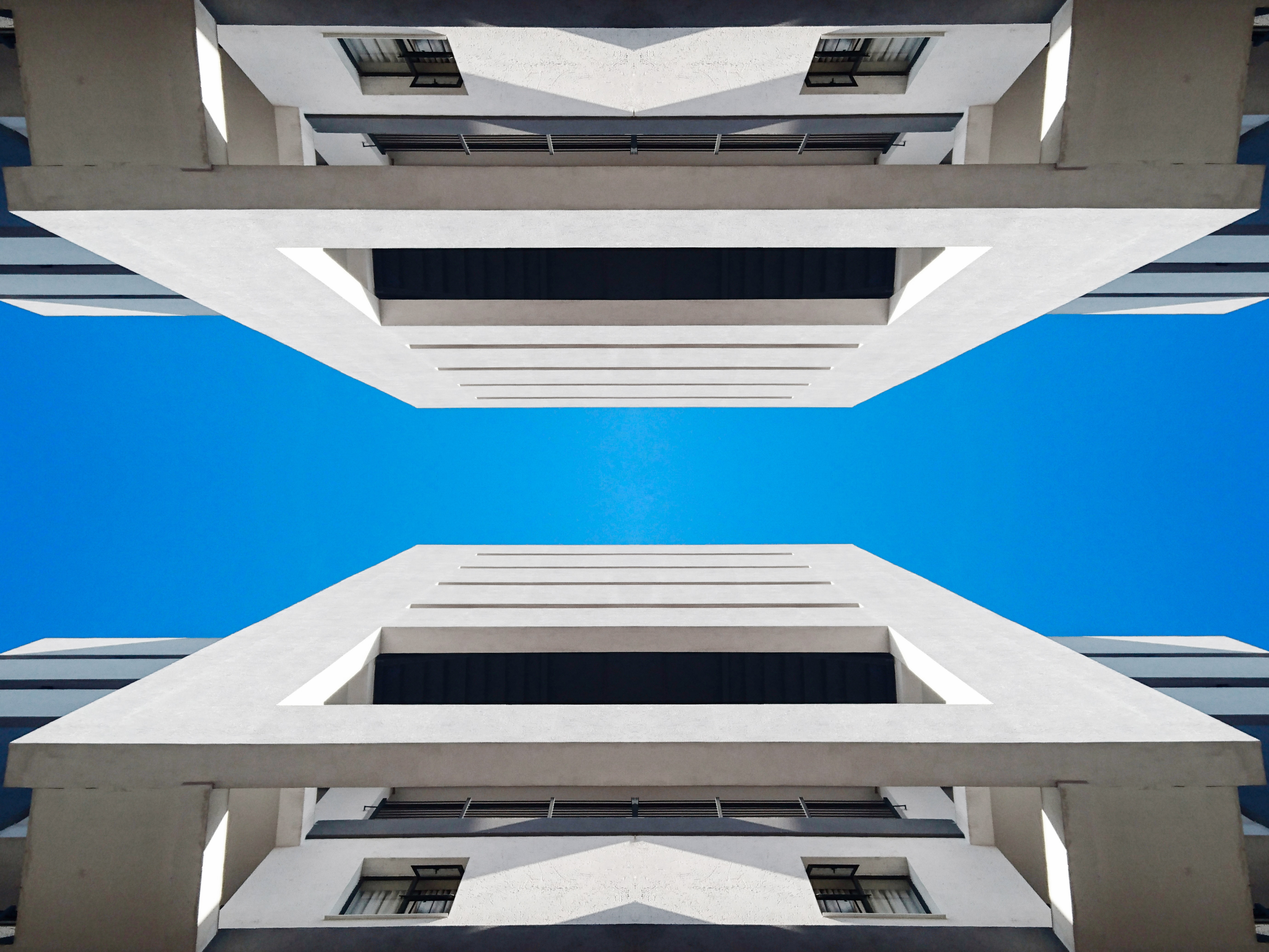 architectural photography of white high-rise building