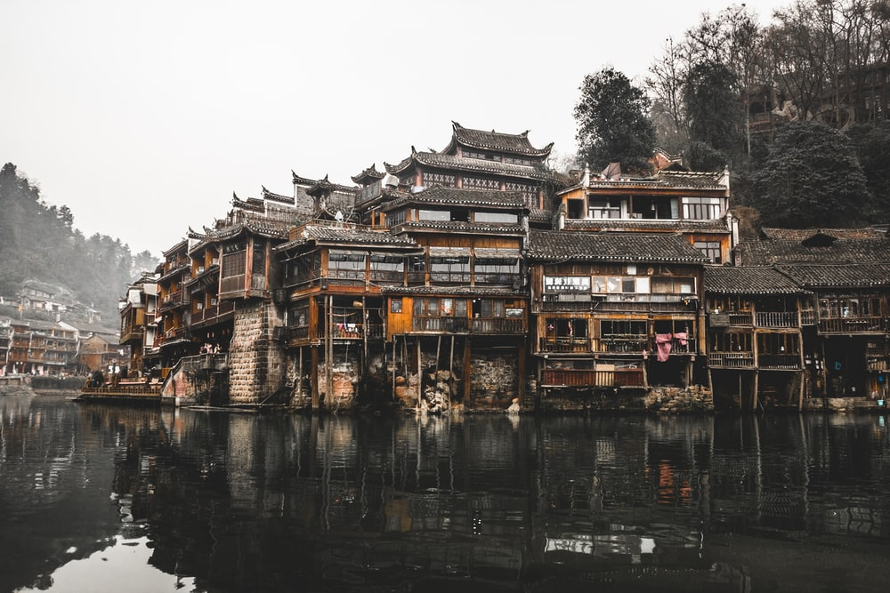 brown wooden houses beside river