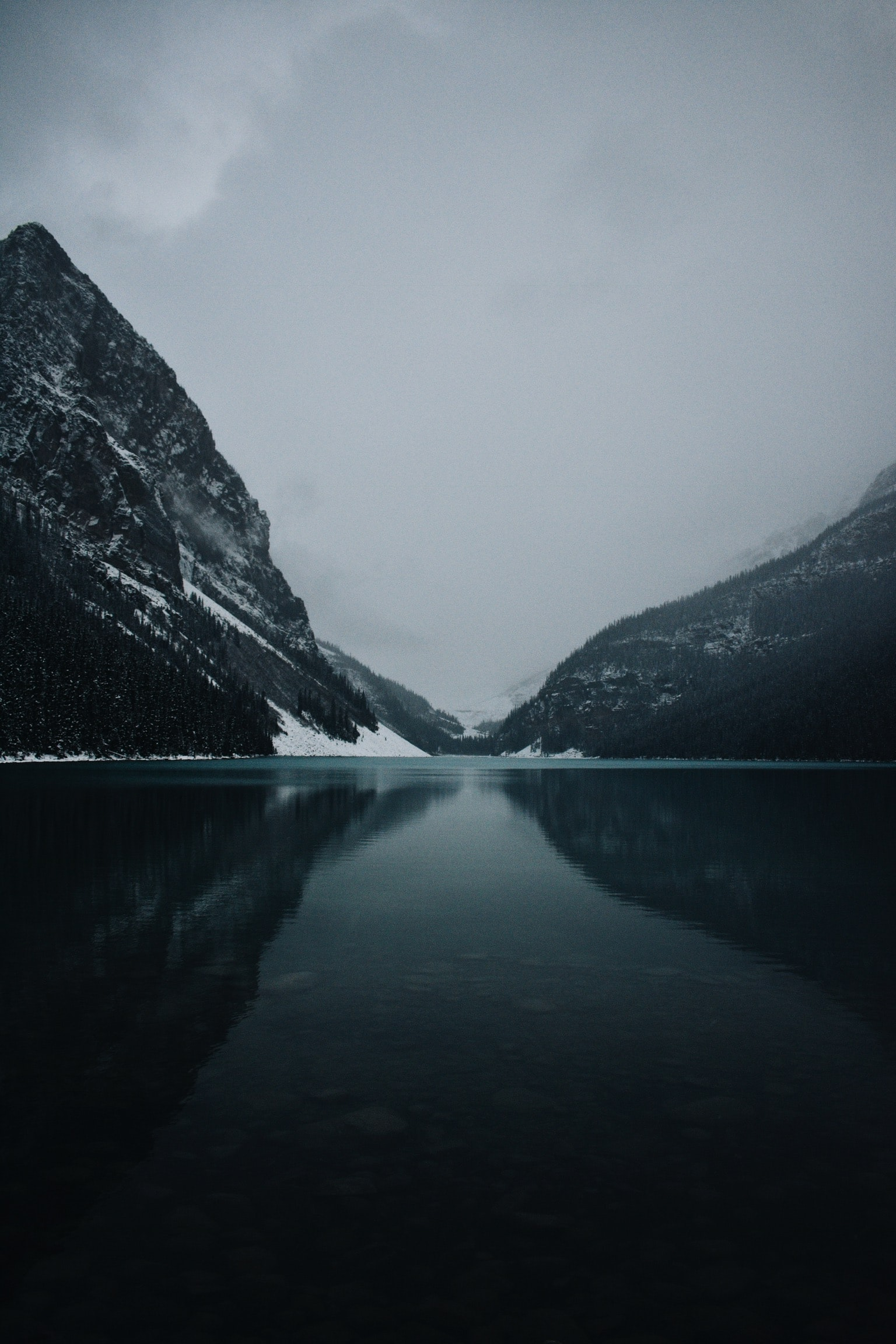 body of water near mountains photography