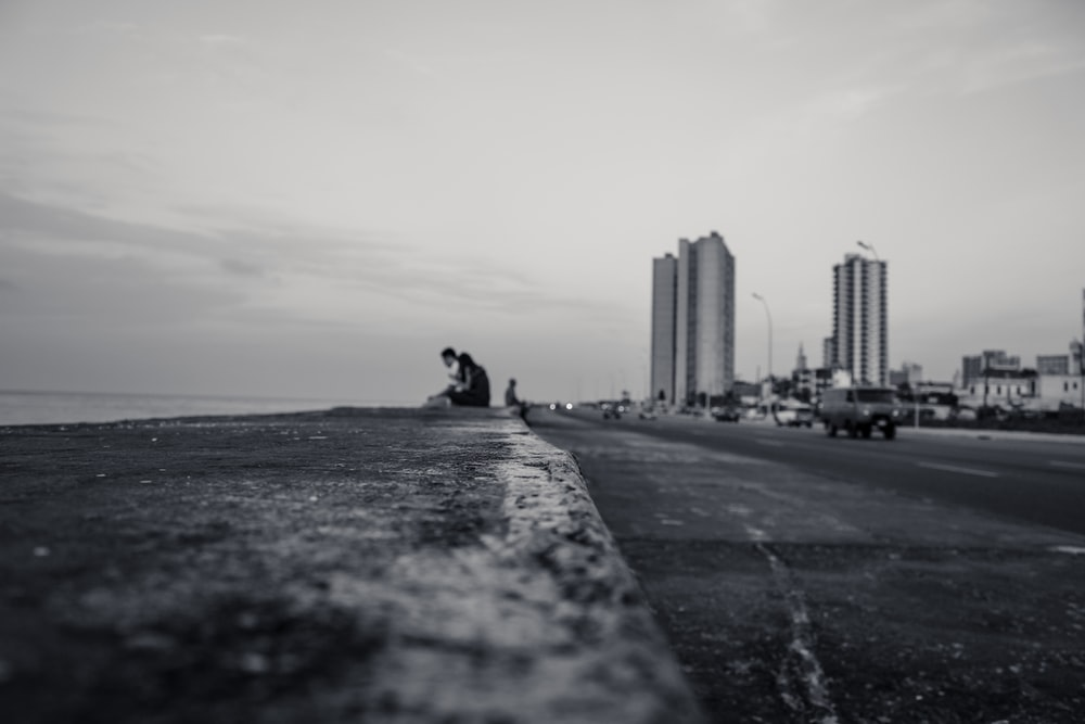 low angle photo of couple sitting near bodies of water