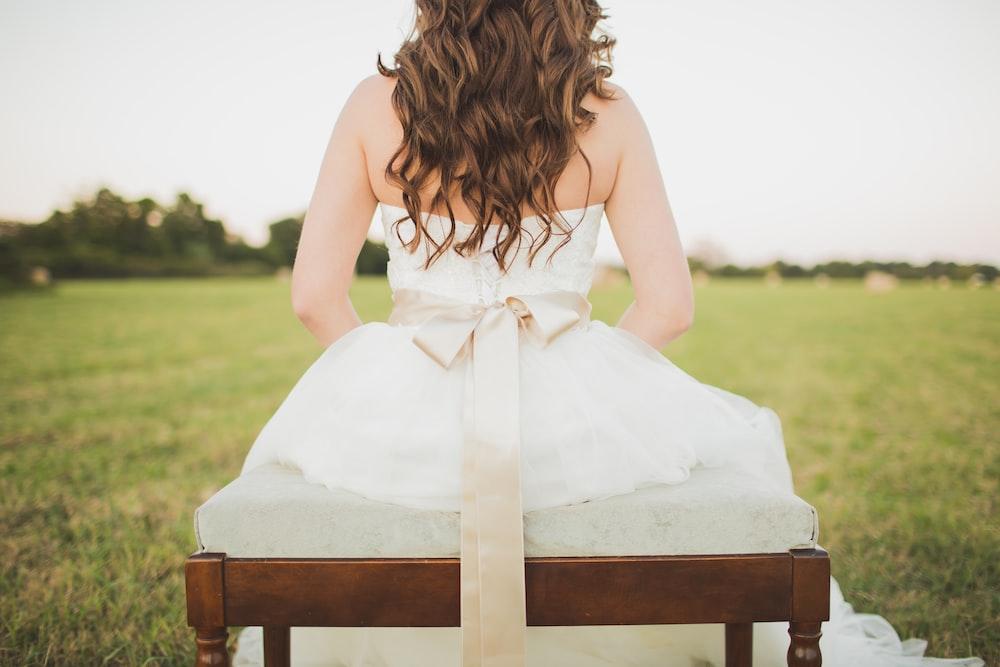 sitting woman wearing white dress