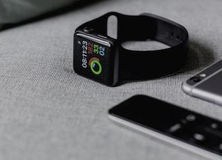 black smartwatch showing 08:11:23