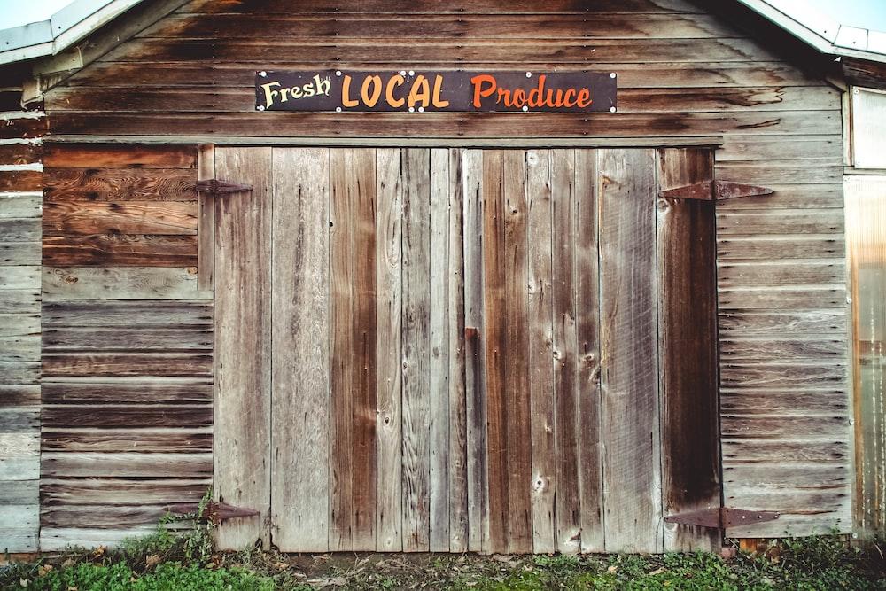 brown wooden door with UNK UNK UNK text