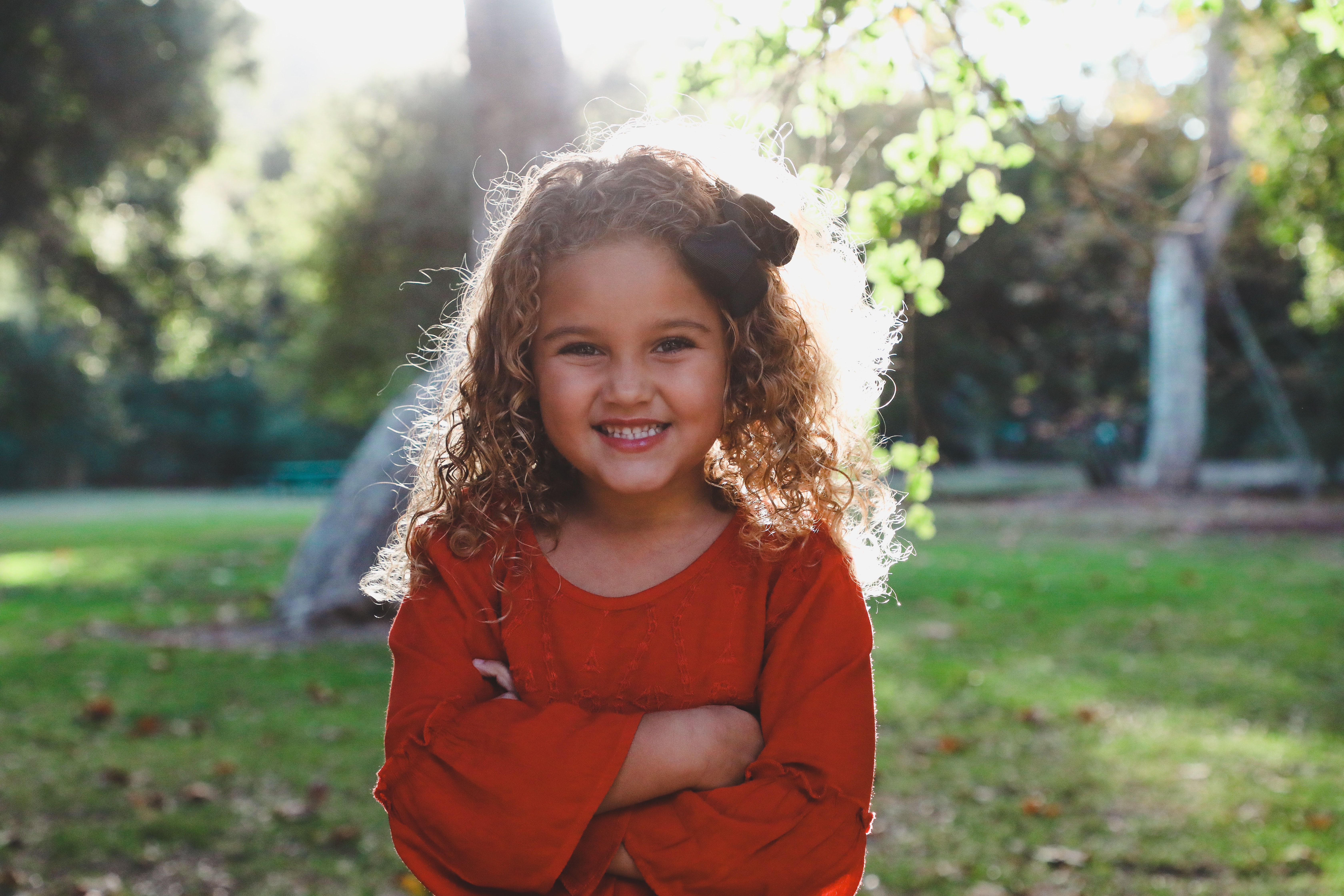 shallow focus photography of girl in red long-sleeved top
