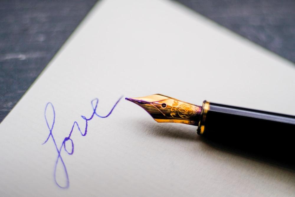 black fountain pen on white paper