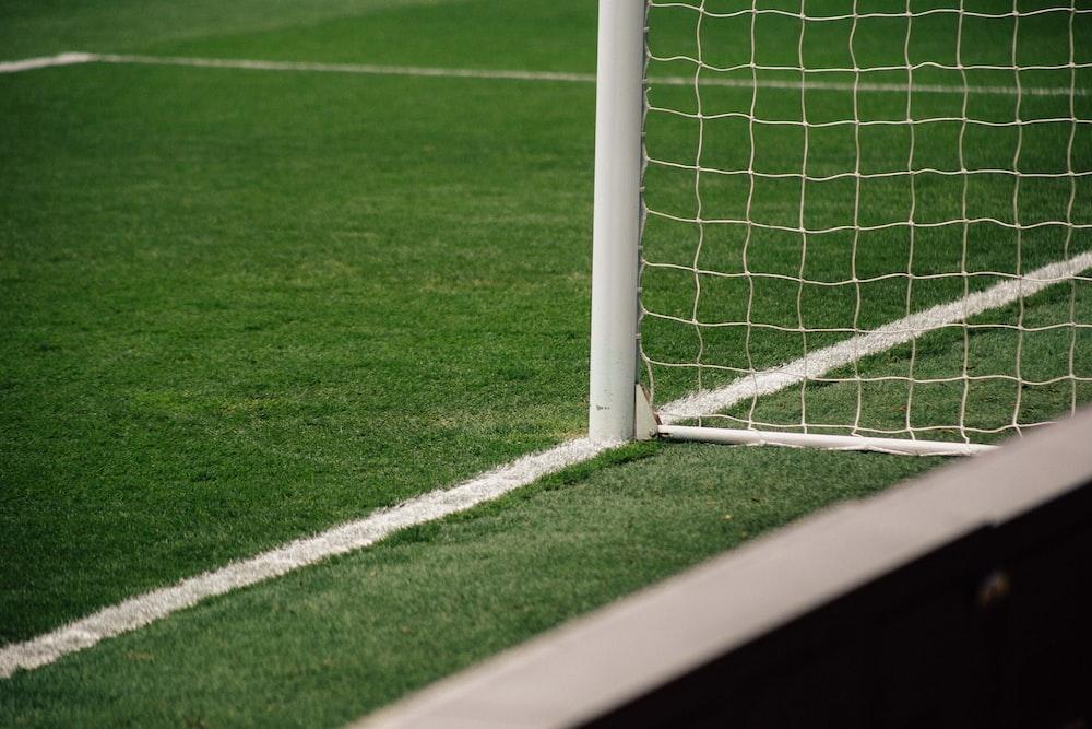 white soccer goal on focus photo