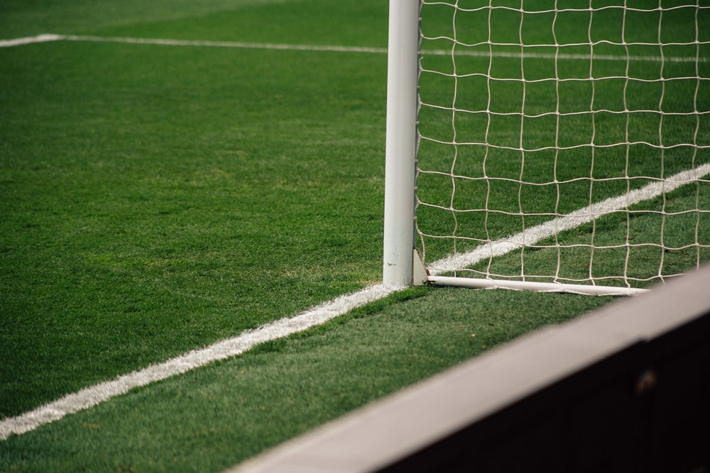 white soccer goal on focus photo