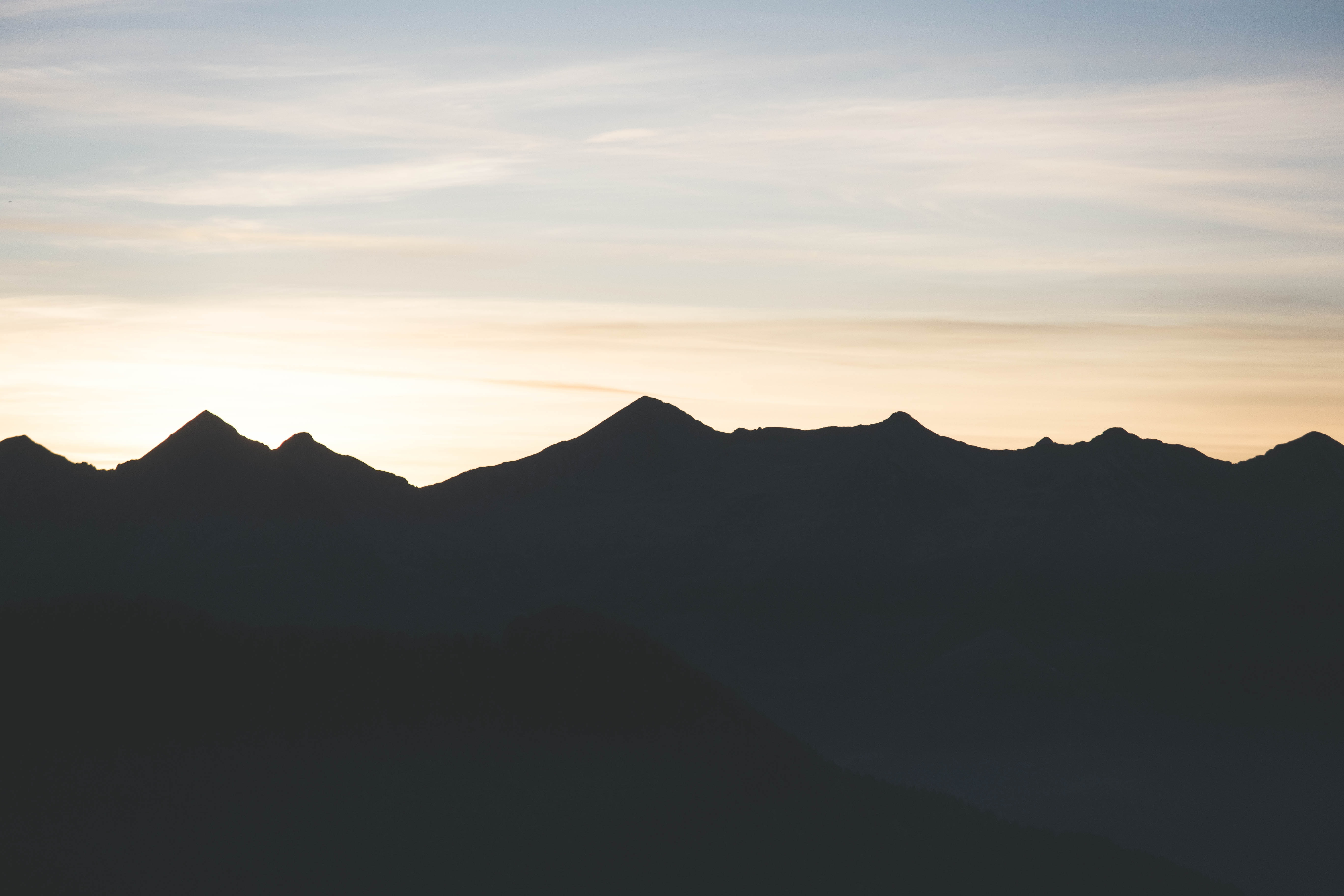 silhouette of mountain range during sunrise/sunset
