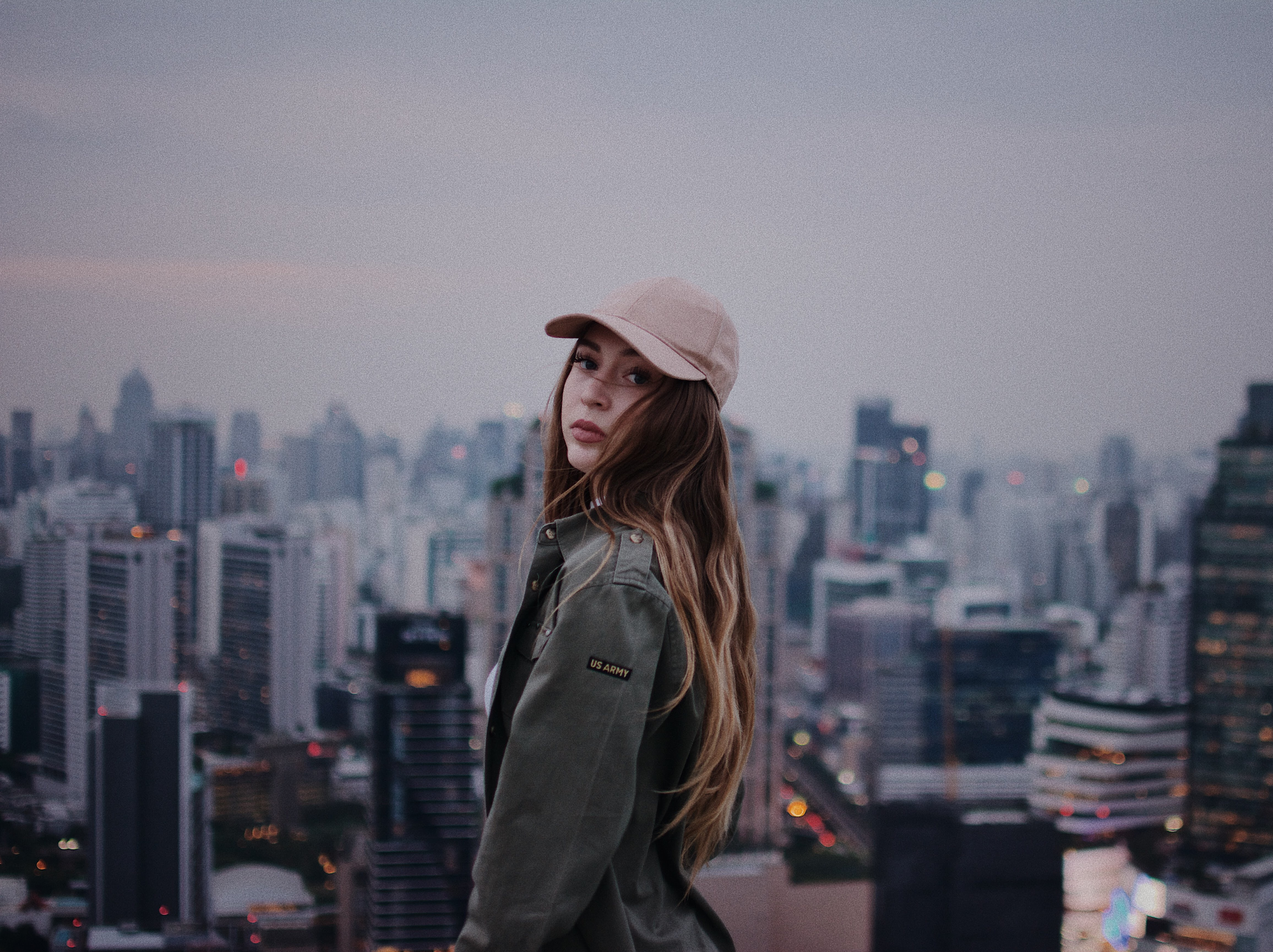 woman standing at the top of building