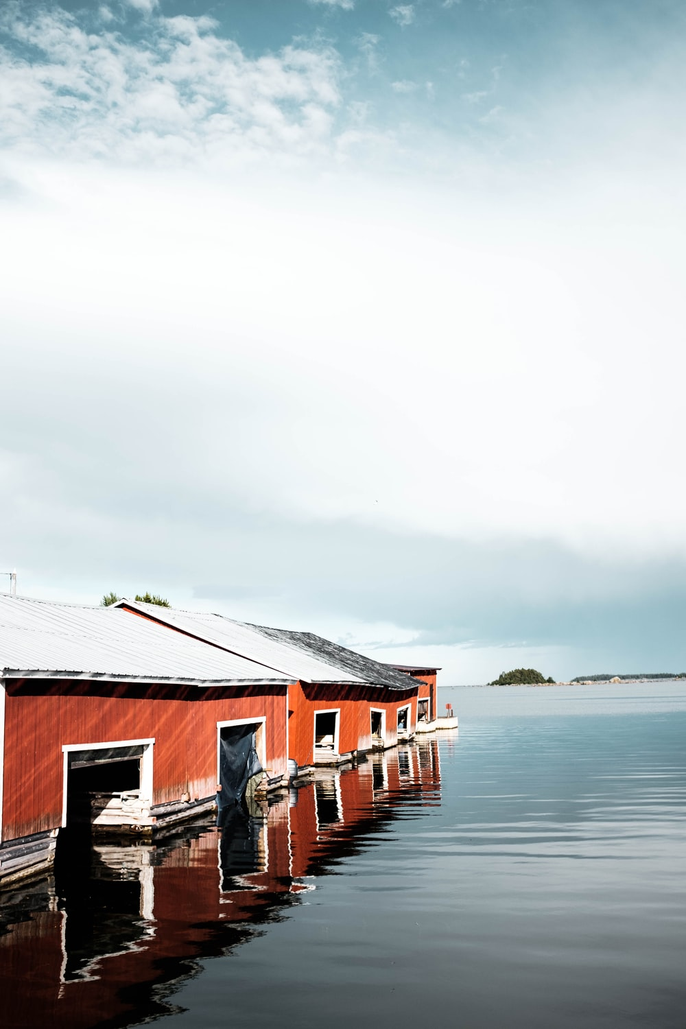 brown houses surrounded by body of water during daytime