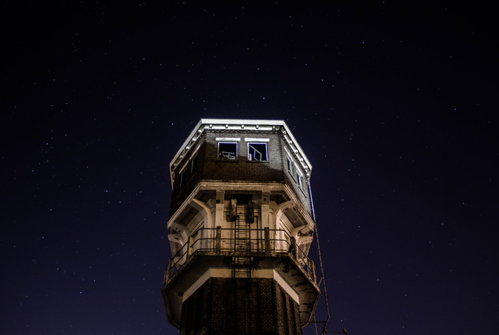 low-angled photography of tower at night