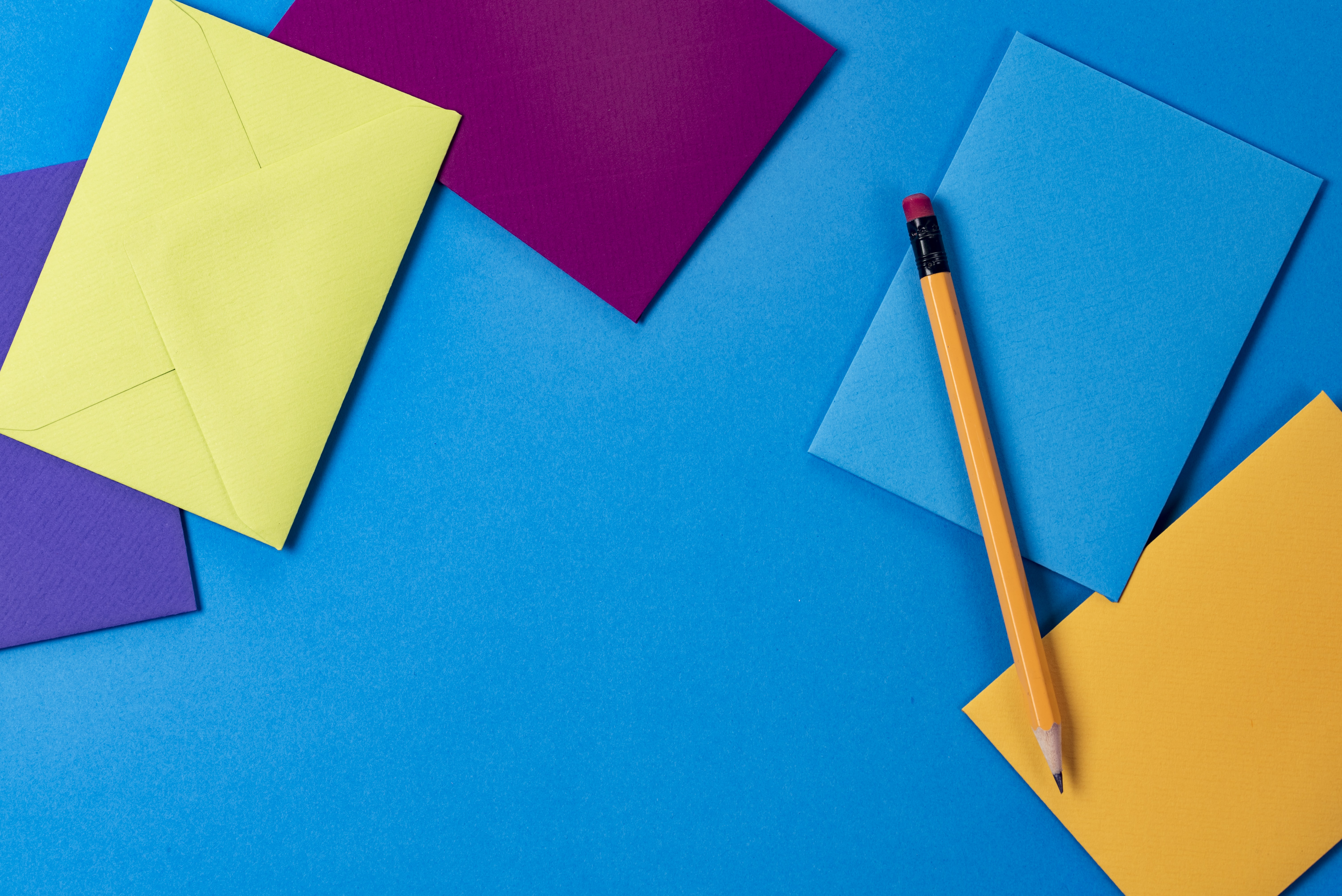 assorted-color paper and brown wooden pencil
