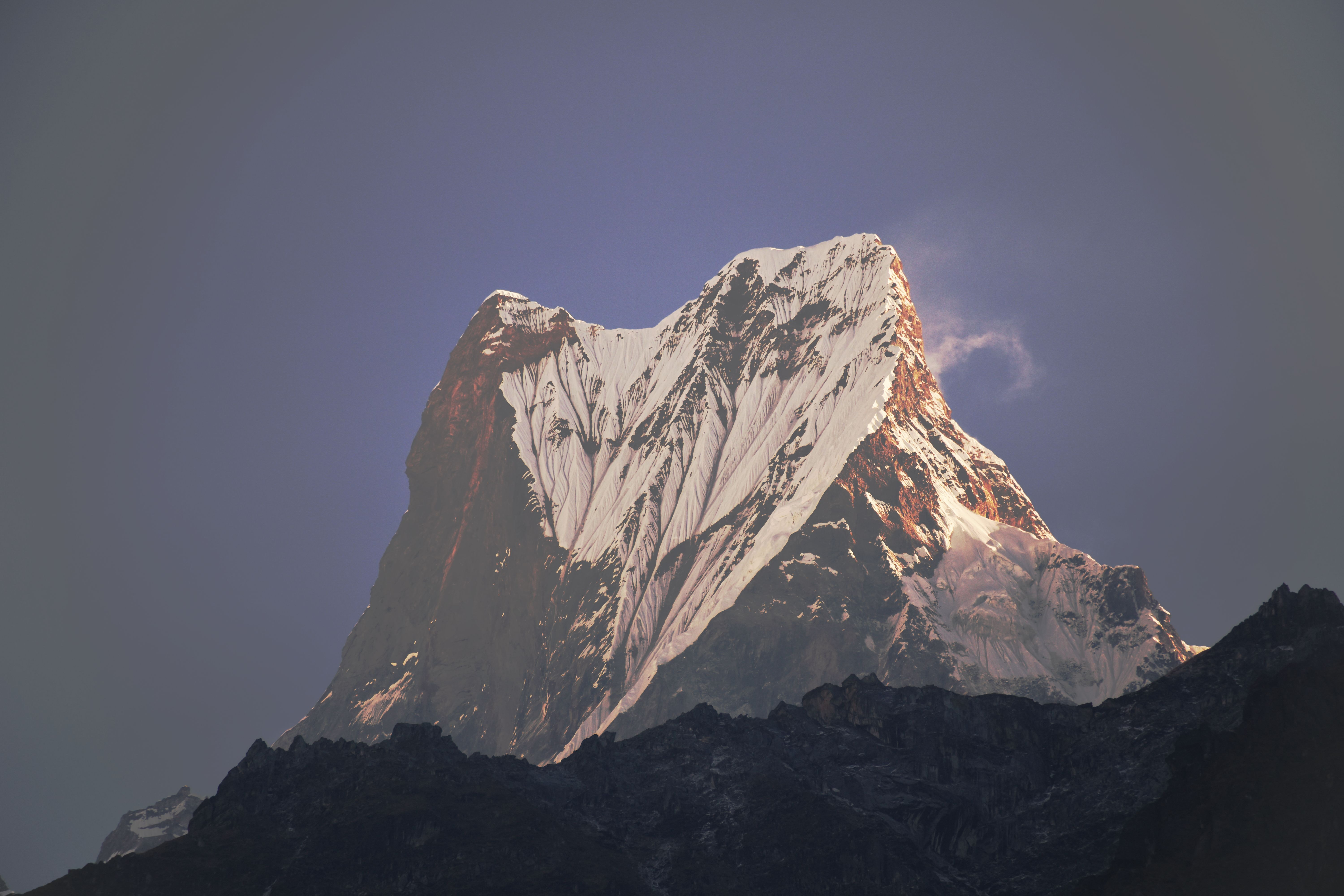 focus photo of mountain covered with snow during daytime