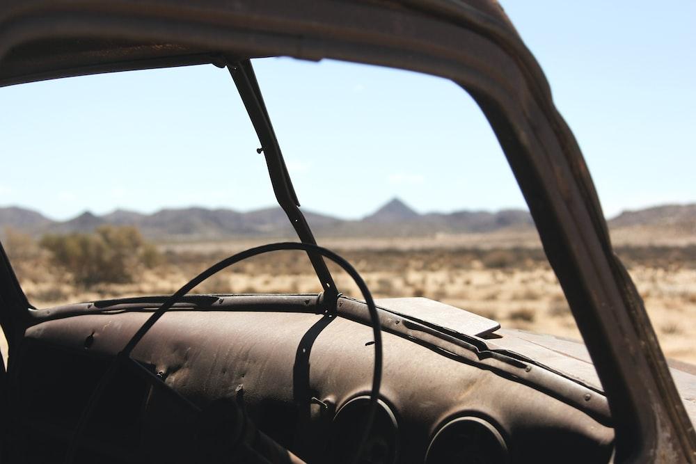 black car steering wheel in shallow focus lens