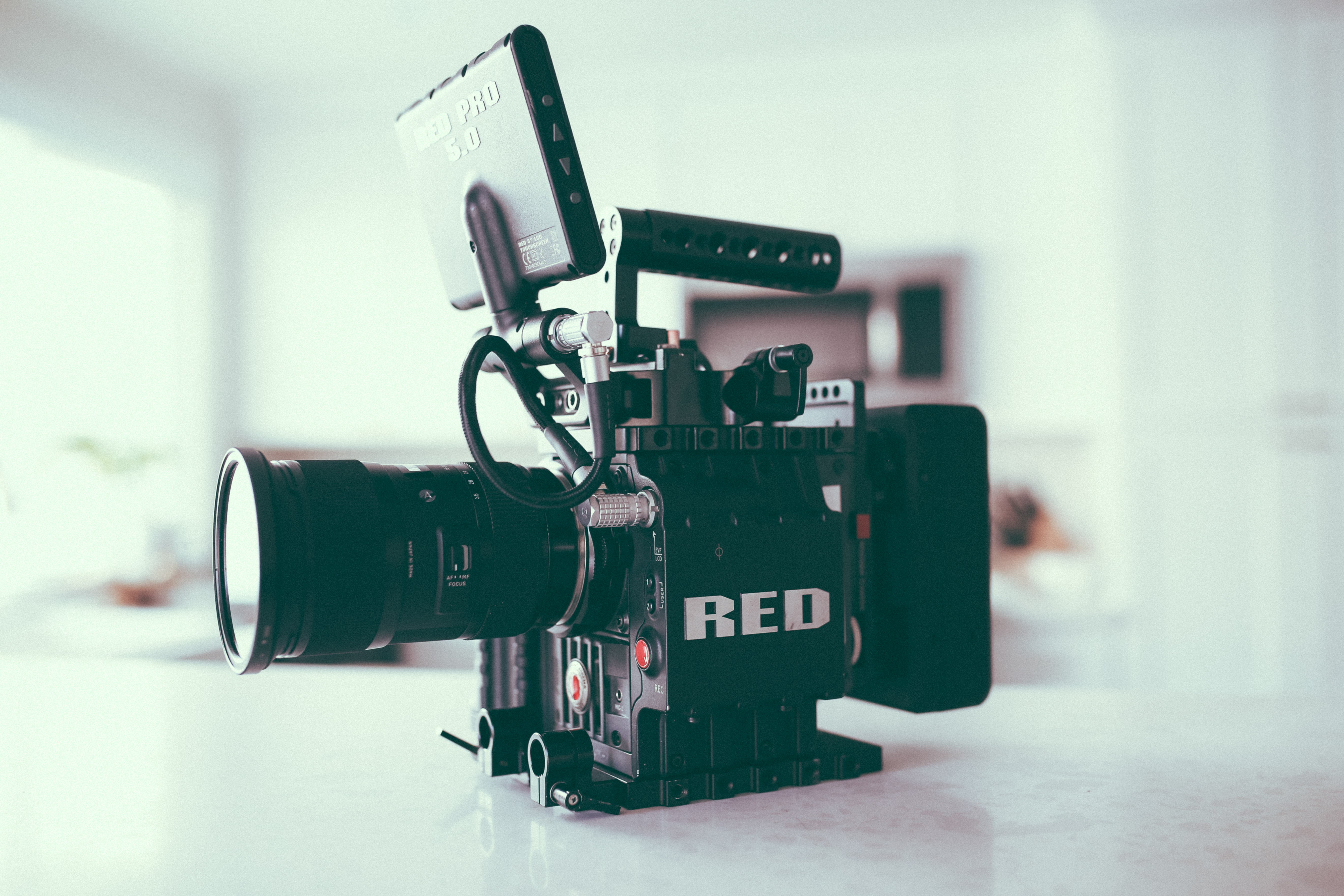 black red video recorder on white surface