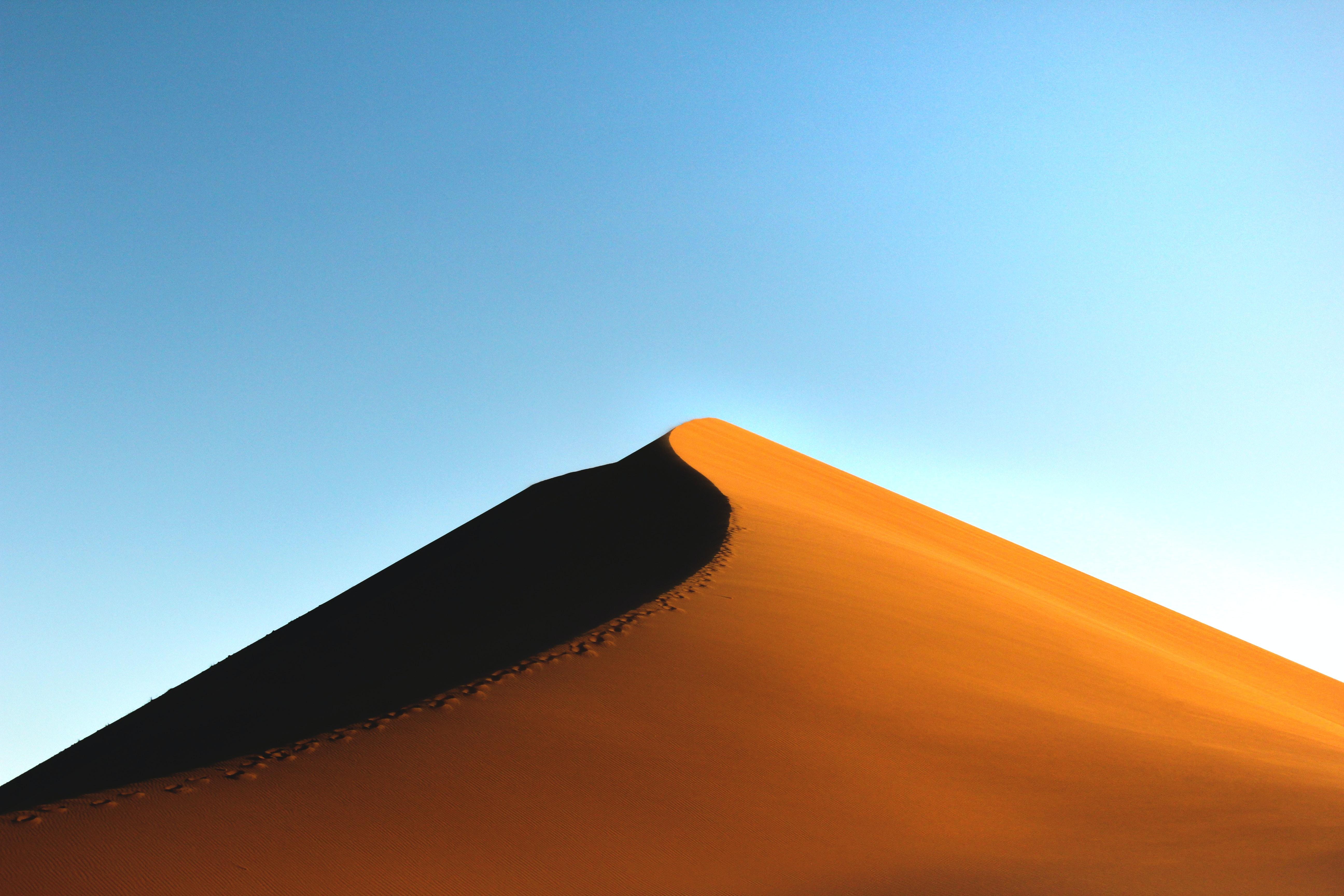 sand dune during daytime