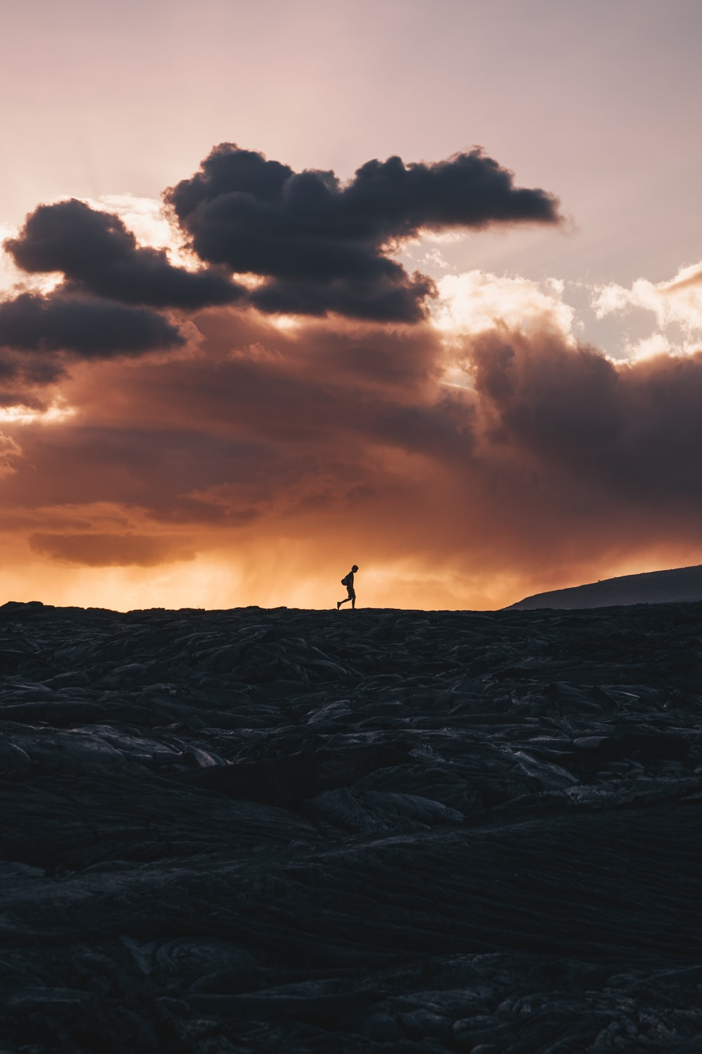 landscape photo of person walking on horizon