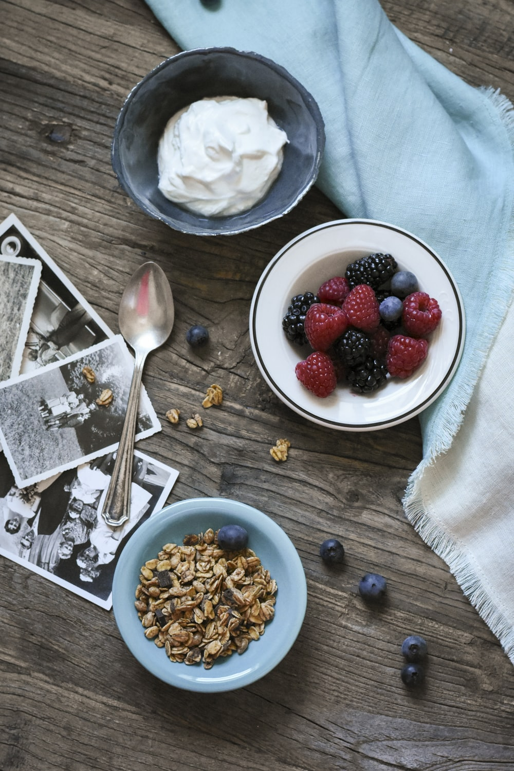 flat lay photograph of raspberries and whip cream