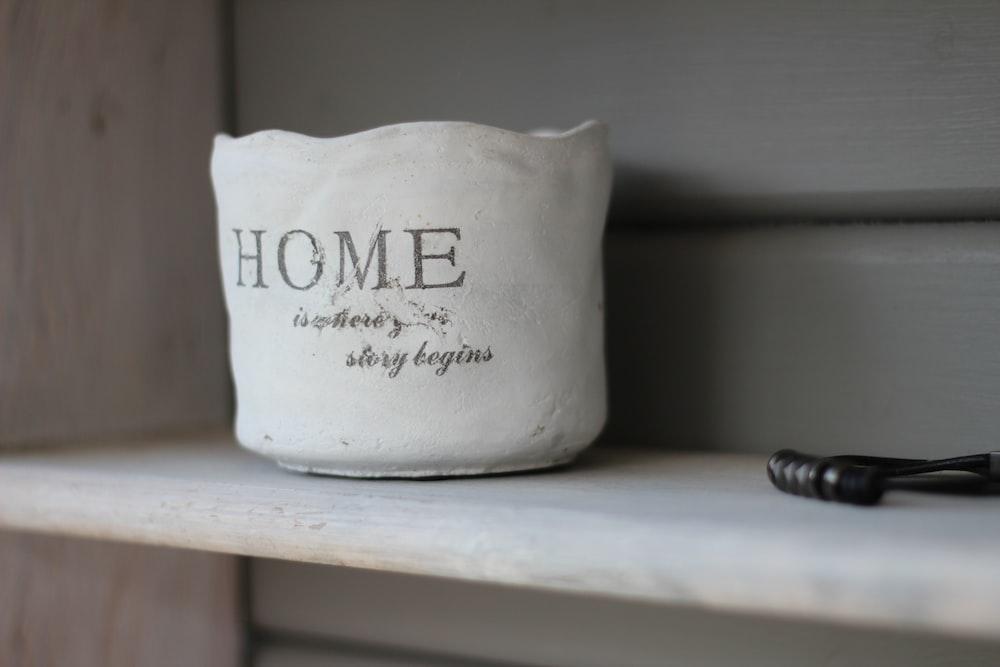 white Home printer vase on white wooden board