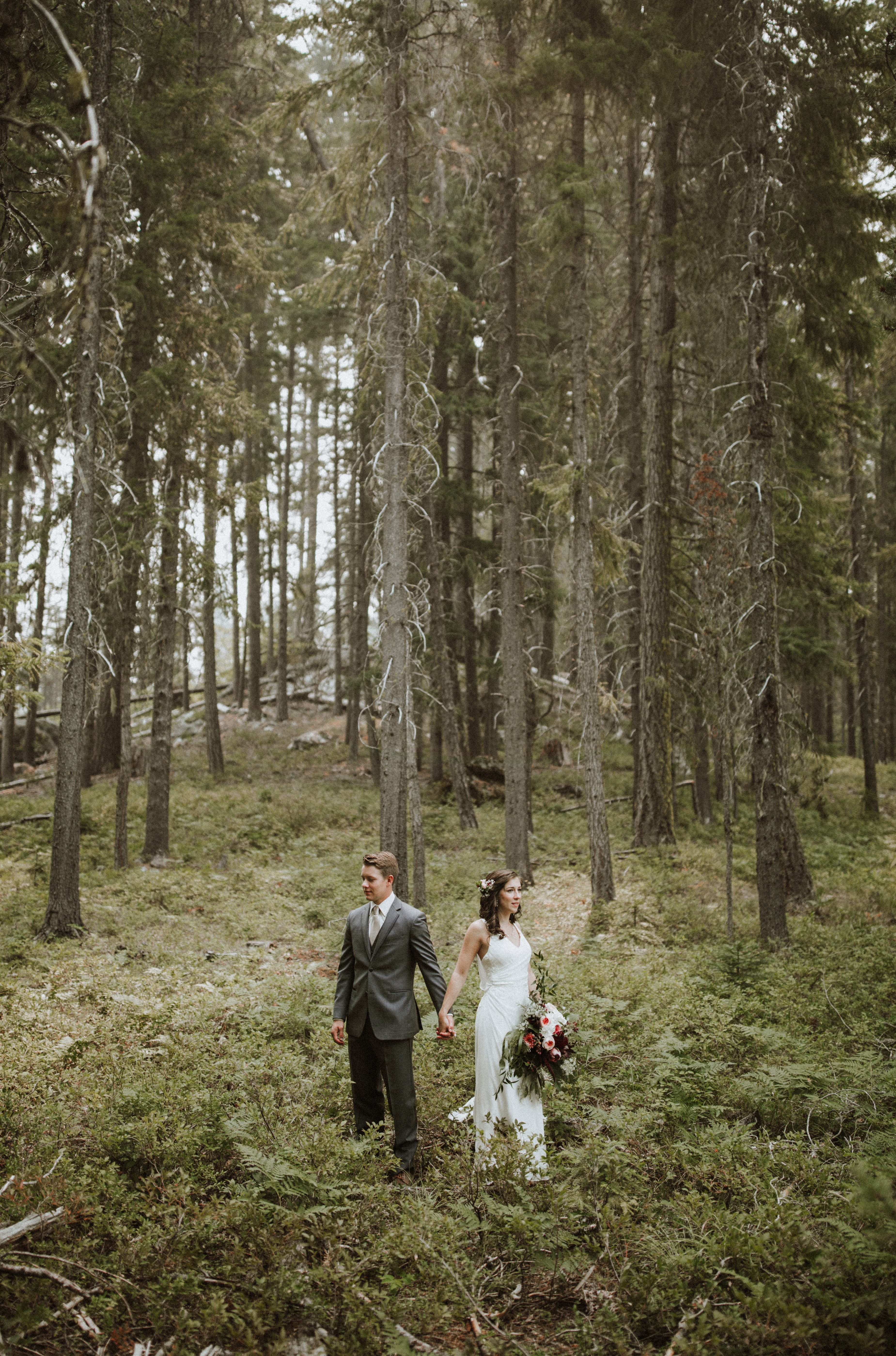 couple standing near trees during daytime