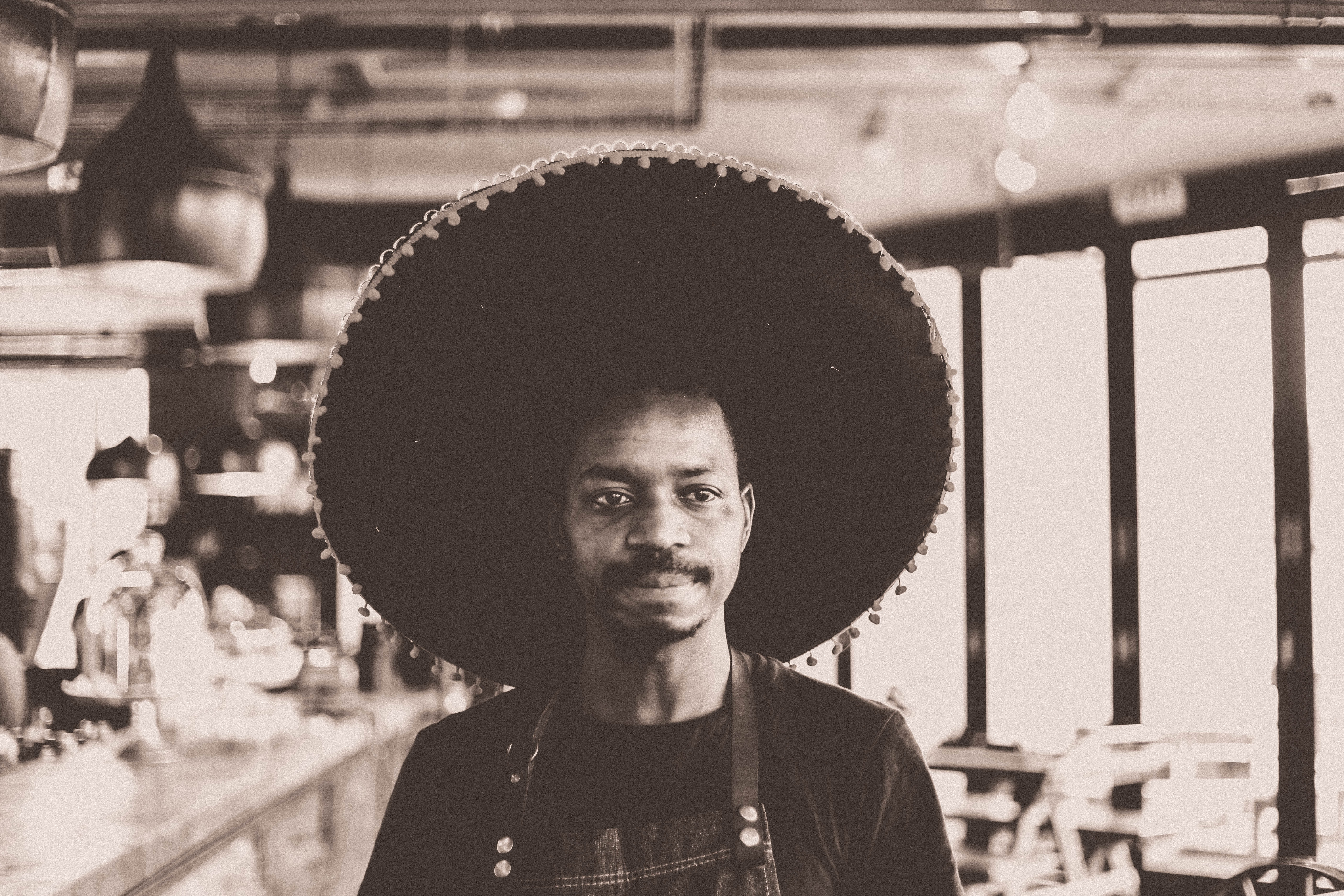 grayscale photo of man wearing sombrero