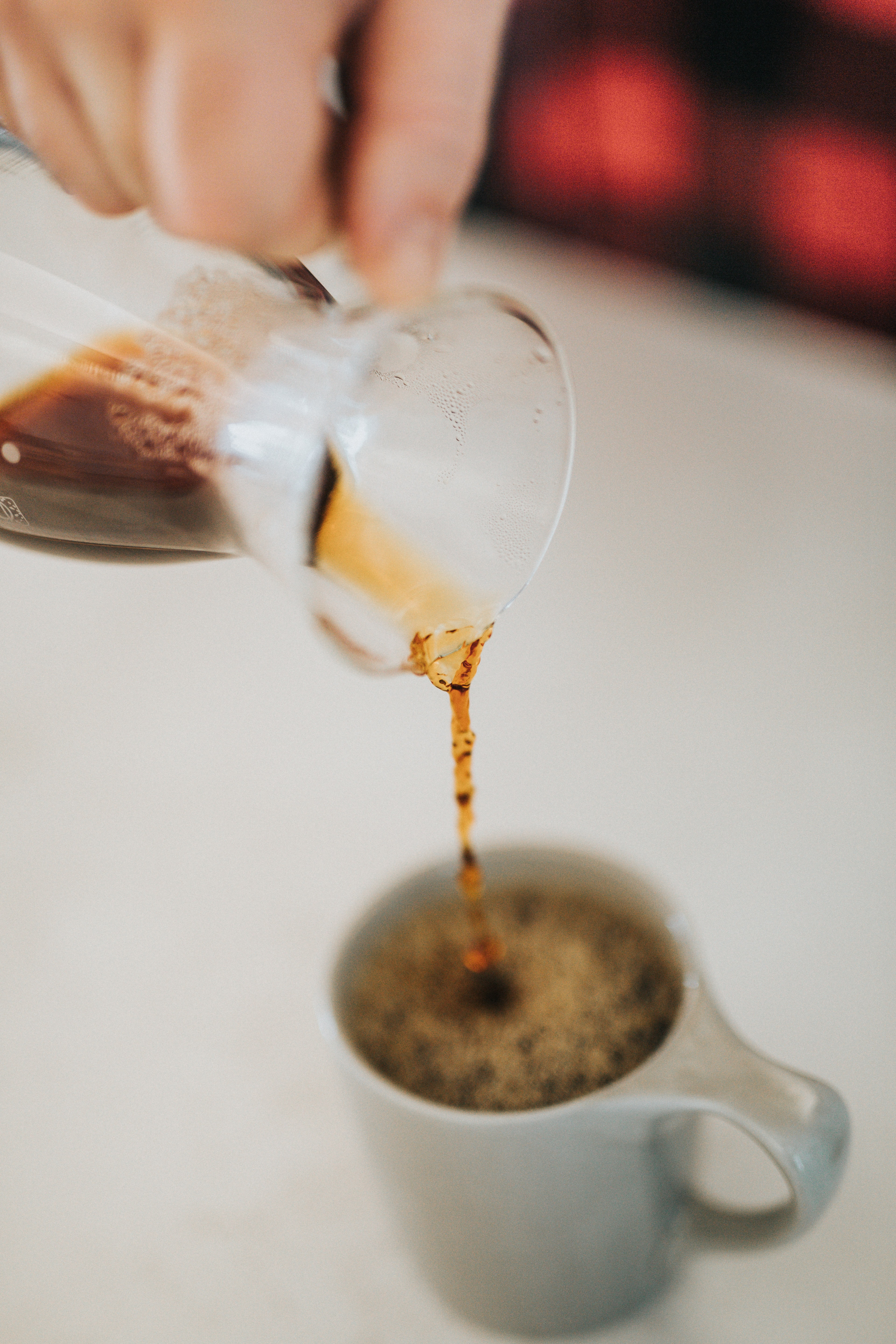 person pouring coffee on gray up