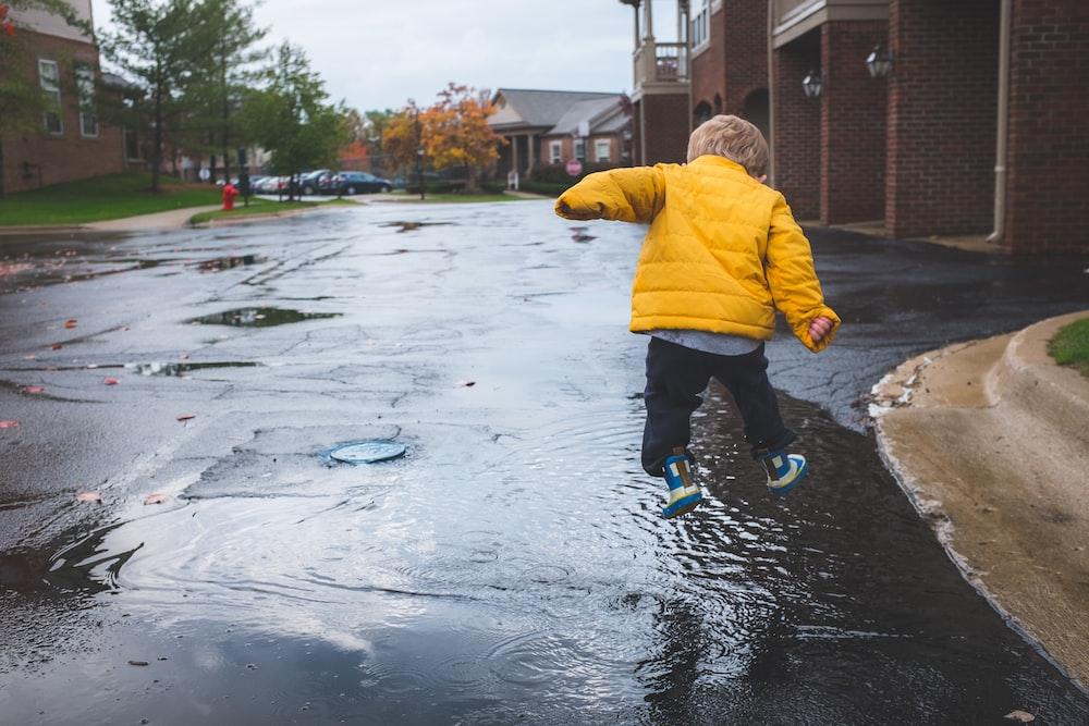 boy jumping on water during daytime