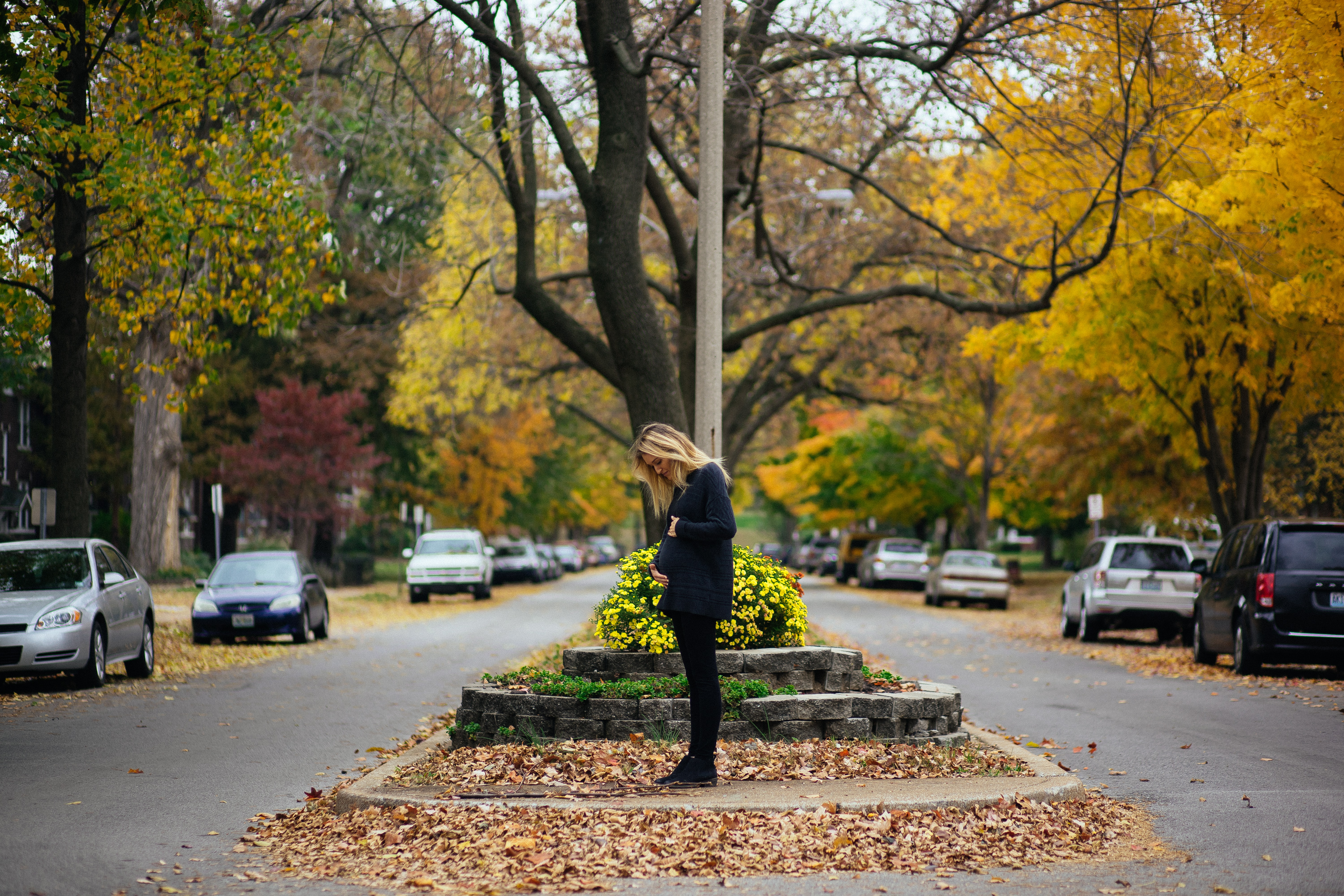 woman standing near tall tree during daytime
