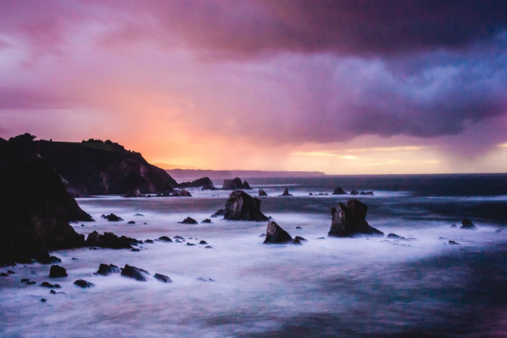 time-lapse photo of sea and rock formation