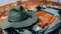round hat on gray bag