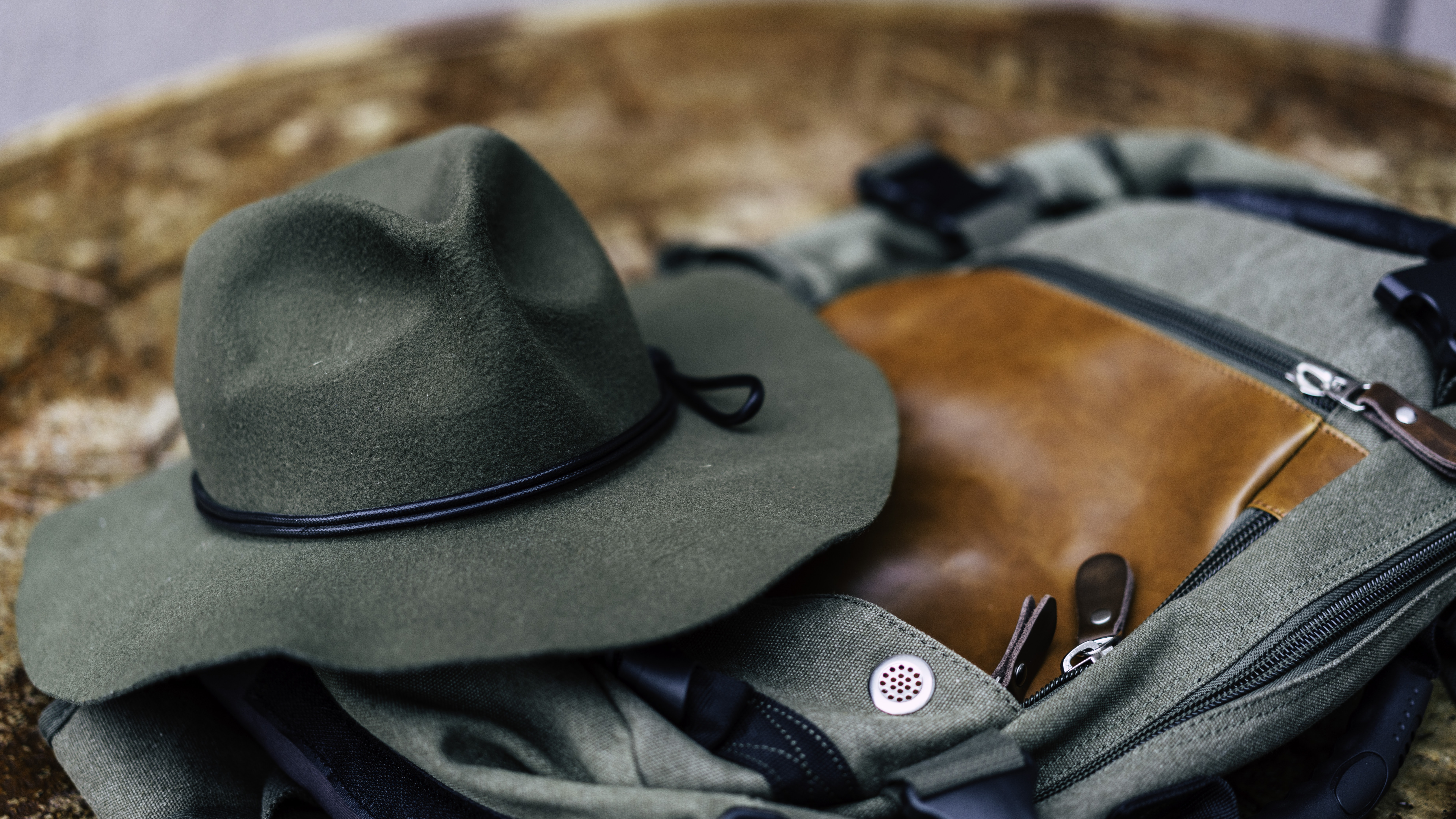 round hat on gray bag