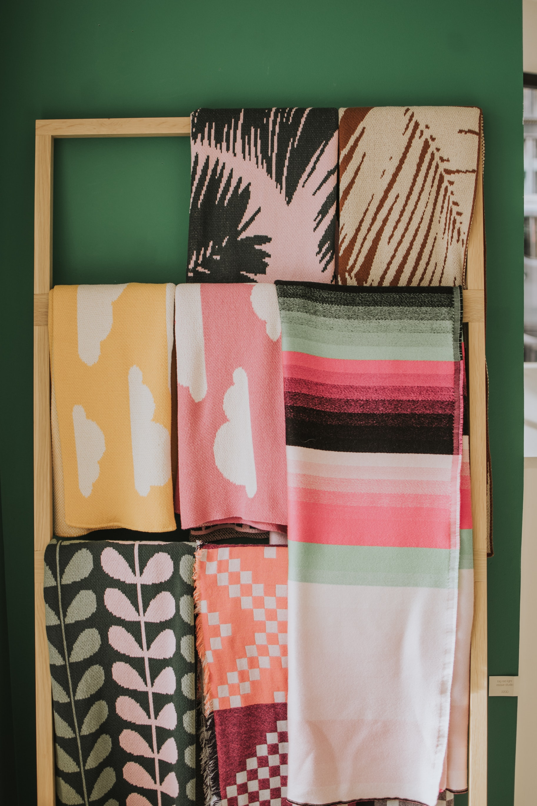 assorted-color textiles hanged on brown valet